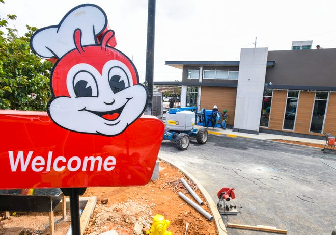 Contractors continue on the construction of the Jollibee restaurant, located on the corner of Marine Corps Drive and Route 16 near the Micronesia Mall in Dededo, on Friday, March 15, 2019. Jollibee Foods Corporation has announce the opening of their flagship brand Jollibee store is slated for Saturday, April 6, 2019.