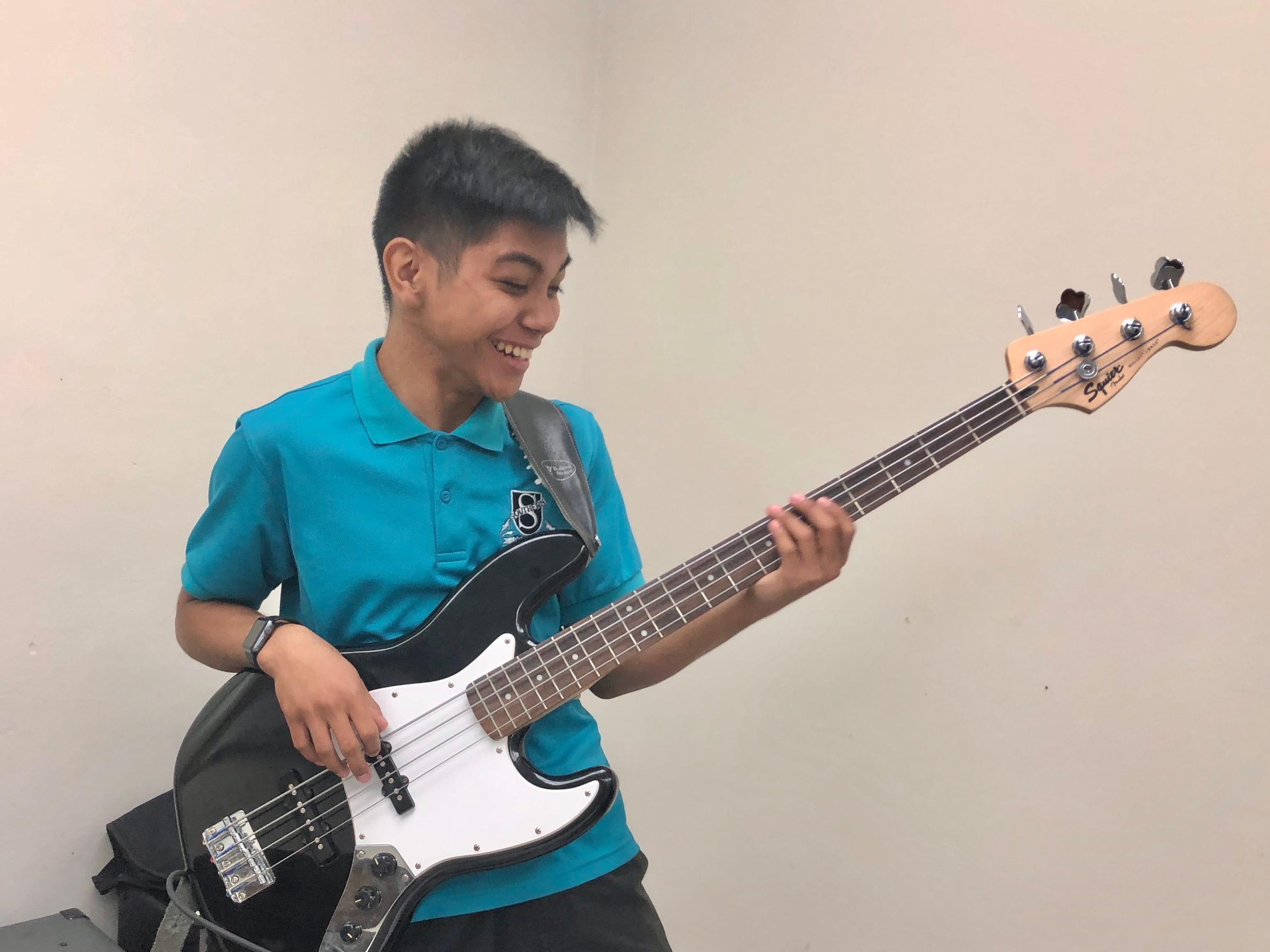 Skyler Gumataotao one of the longest members in band class plays the bass guitar on March 15, 2019.