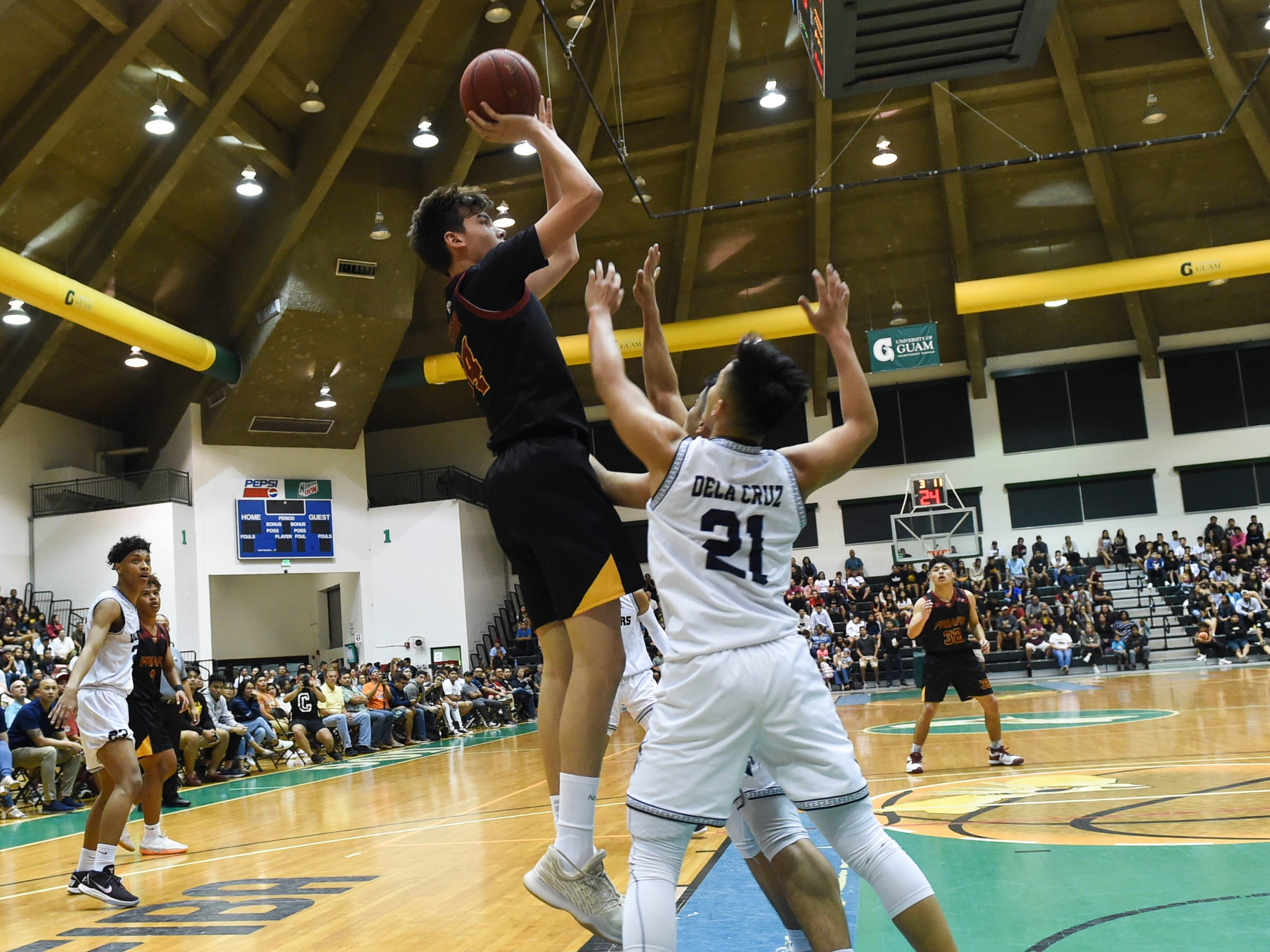 Father Duenas' Matthew Fegurgur shoots a jumper against the St. Paul Warriors during the IIAAG Boys' Basketball Championship game at the University of Guam Calvo Field House in Mangilao, March 15, 2019.