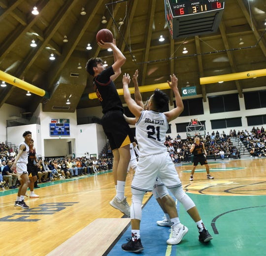 In this file photo from March 15, 2019, Father Duenas' Matt Fegurgur shoots a jumper against the St. Paul Warriors during the IIAAG Boys' Basketball Championship game at the University of Guam Calvo Field House in Mangilao. Boys basketball will have a different look with two separate leagues when school resumes in January.
