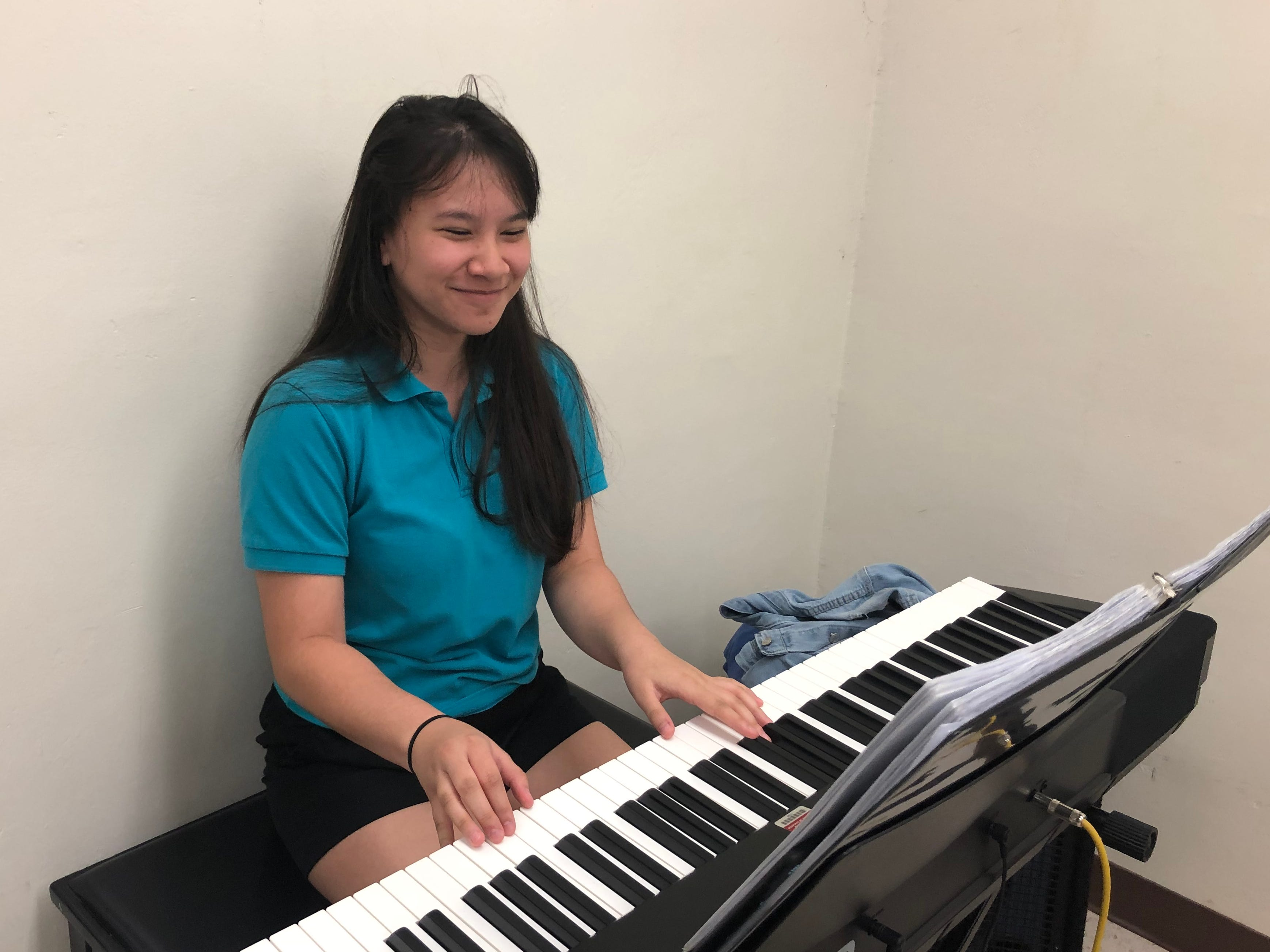 Sommer Torre of Asan and a member of Southern Variety playing the keyboard on March 15, 2019.