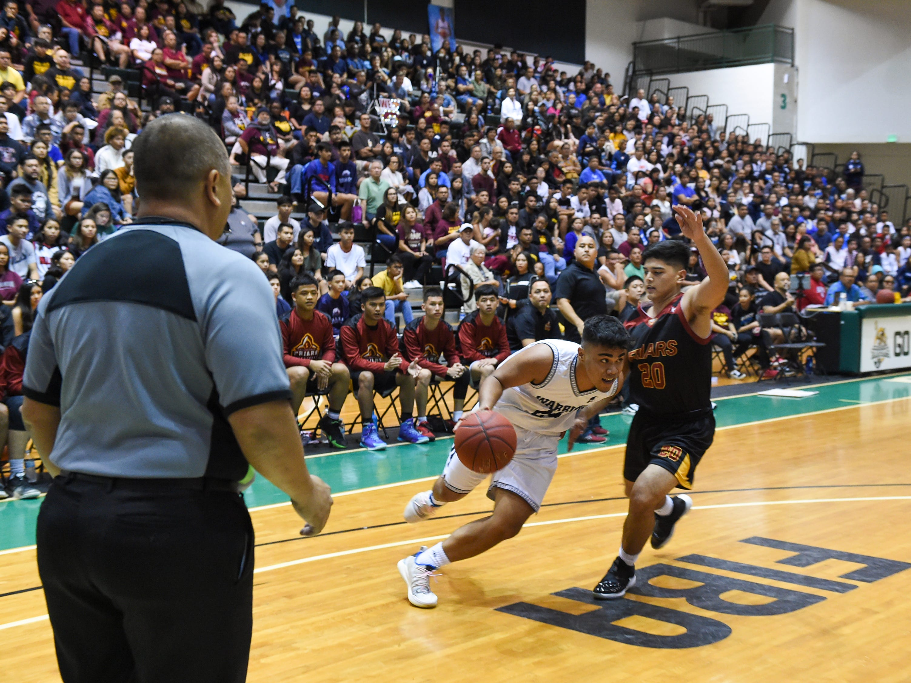 The St. Paul Warriors defeat the Father Duenas Friars 44-41 for the IIAAG Boys' Basketball Championship at the University of Guam Calvo Field House in Mangilao, March 15, 2019.