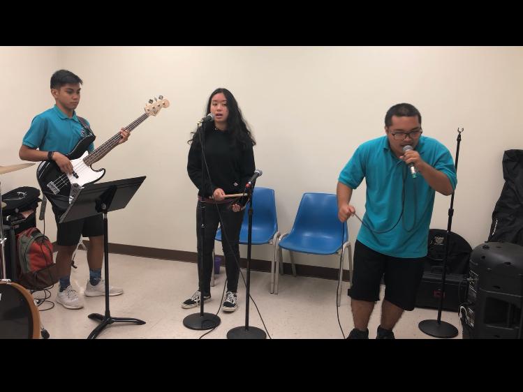 From left: Skyler Gumataotao, Darien Fejarang and Edward James Sarrosa performing on March 15, 2019.