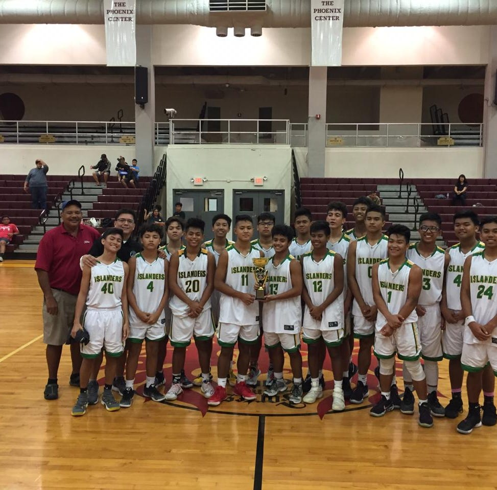 JFK Islanders win JV basketball title, beating Okkodo Bulldogs 61-55