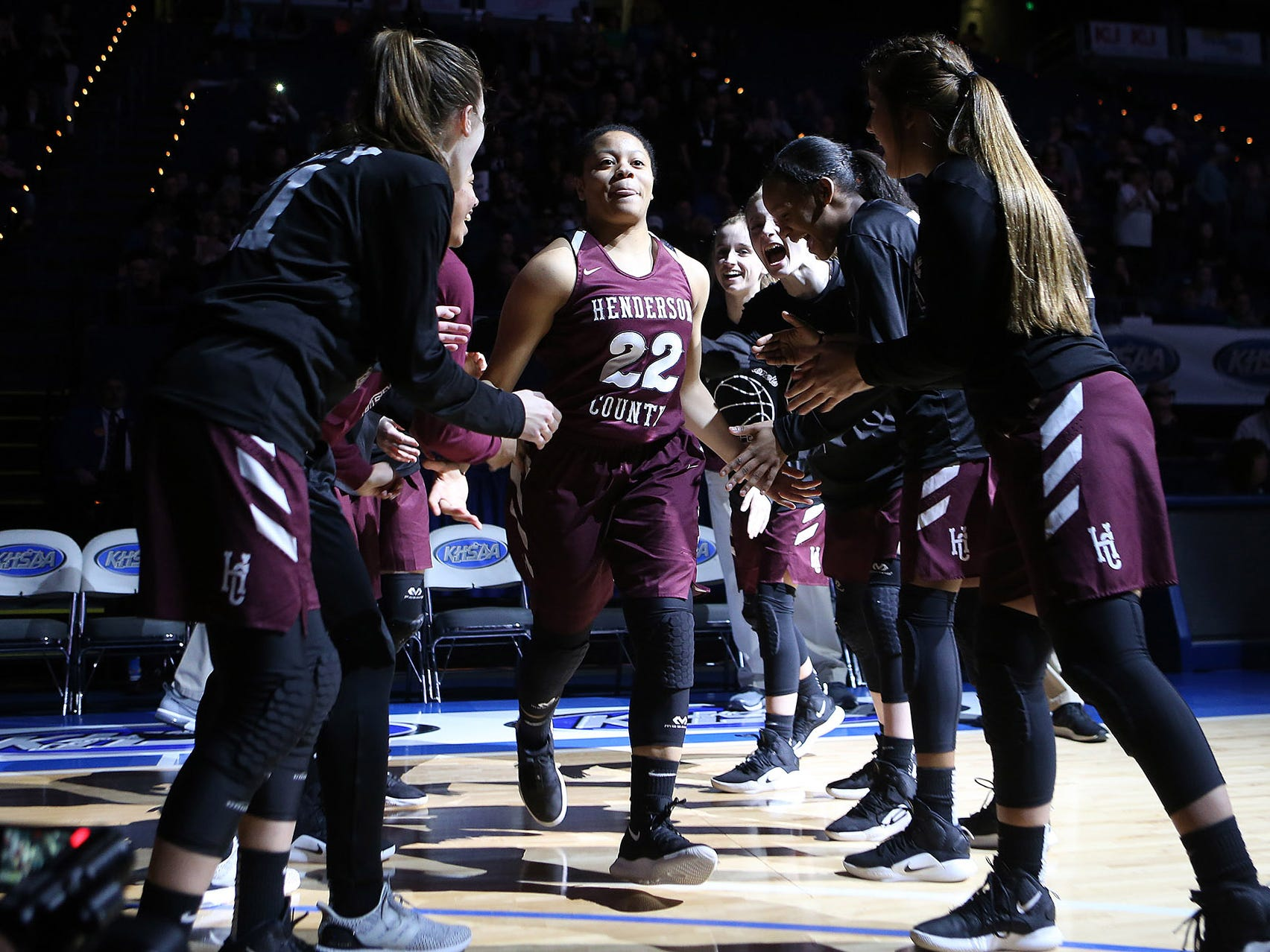 Henderson County's Lauren Hubbard slapped hands with teammates during introduction of starting lineups Friday against North Laurel in Game 8 of the KHSAA Girls' Sweet 16 at Rupp Arena in Lexington.