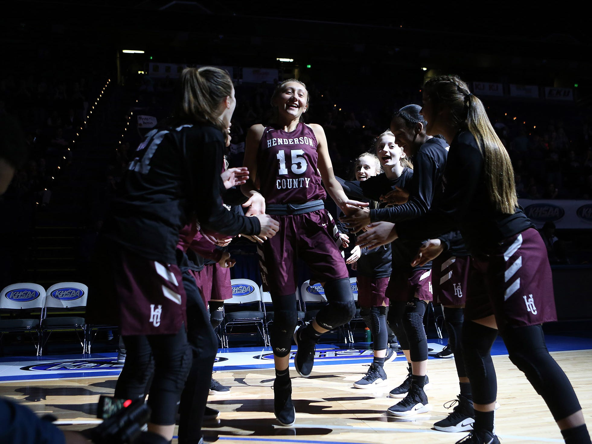 Henderson County's Alyssa Dickson slapped hands with teammates during introduction of starting lineups Friday against North Laurel in Game 8 of the KHSAA Girls' Sweet 16 at Rupp Arena in Lexington.