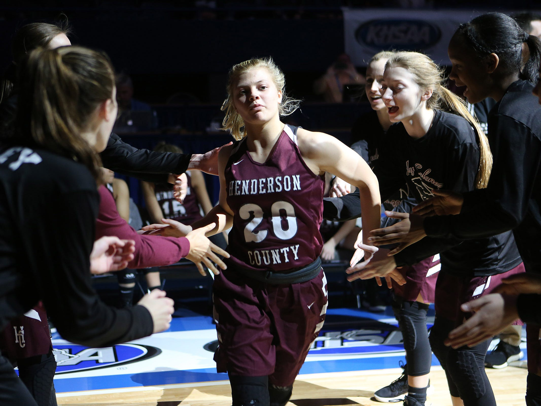 Henderson County's Kaytlan Kemp slapped hands with teammates during introduction of starting lineups Friday against North Laurel in Game 8 of the KHSAA Girls' Sweet 16 at Rupp Arena in Lexington.