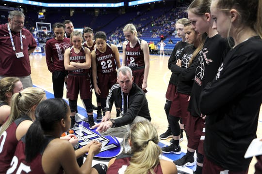 Henderson Co. head coach Jeff Haile talked to the team during a timeout Friday against North Laurel in Game 8 of the KHSAA Girls' Sweet 16 at Rupp Arena in Lexington.