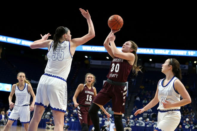 Henderson County's Emilee Hope shot Friday against North Laurel's Raegan Hubbard in Game 8 of the KHSAA Girls' Sweet 16 at Rupp Arena in Lexington.