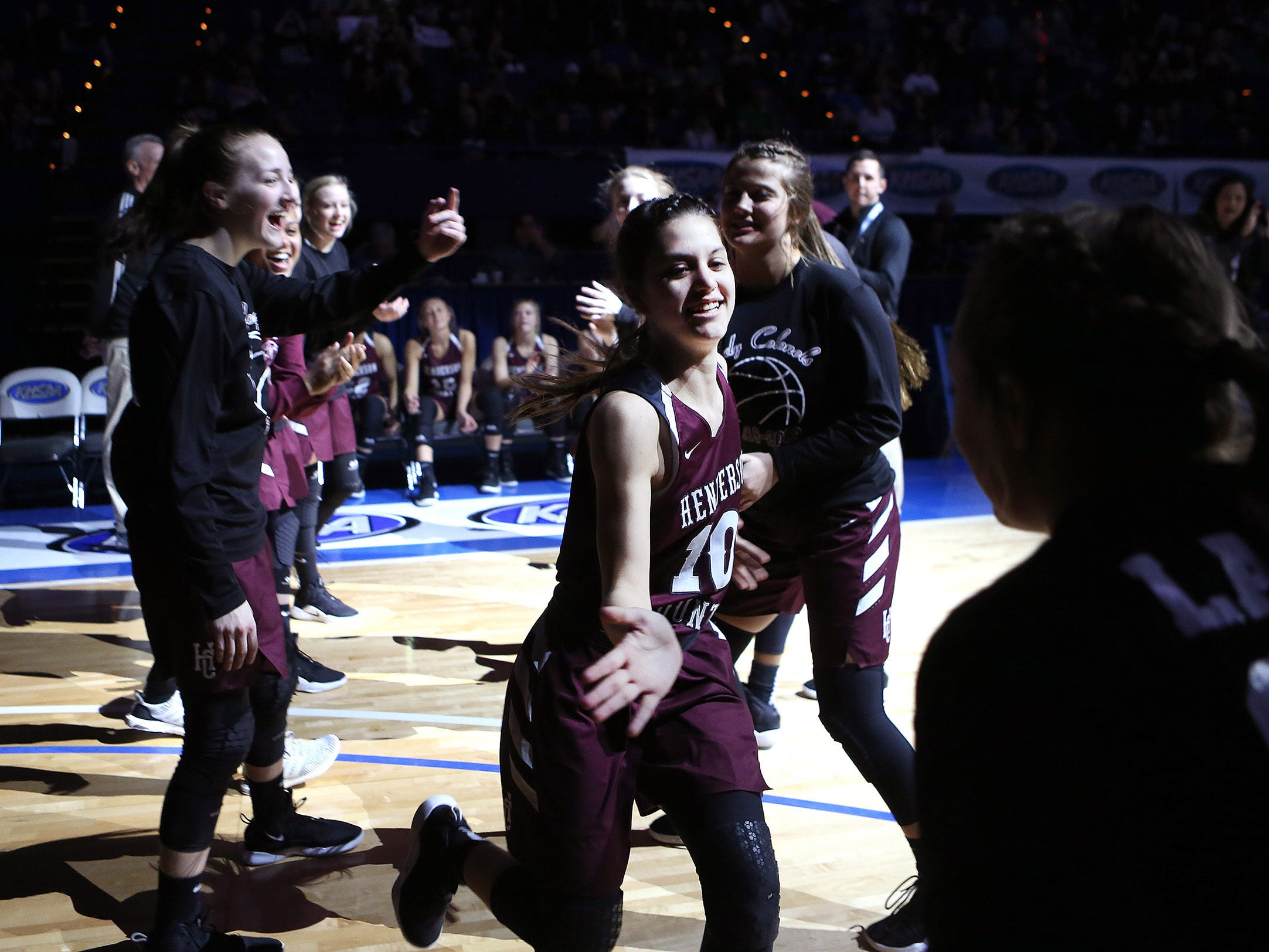 Henderson County's Katie Rideout slapped hands with teammates during introduction of starting lineups Friday against North Laurel in Game 8 of the KHSAA Girls' Sweet 16 at Rupp Arena in Lexington.
