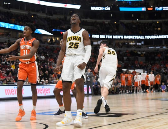 Mar 14, 2019; Chicago, IL, USA; Iowa Hawkeyes forward Tyler Cook (25) reacts after dunking the ball against Illinois Fighting Illini during the second half in the Big Ten conference tournament at United Center. Mandatory Credit: David Banks-USA TODAY Sports