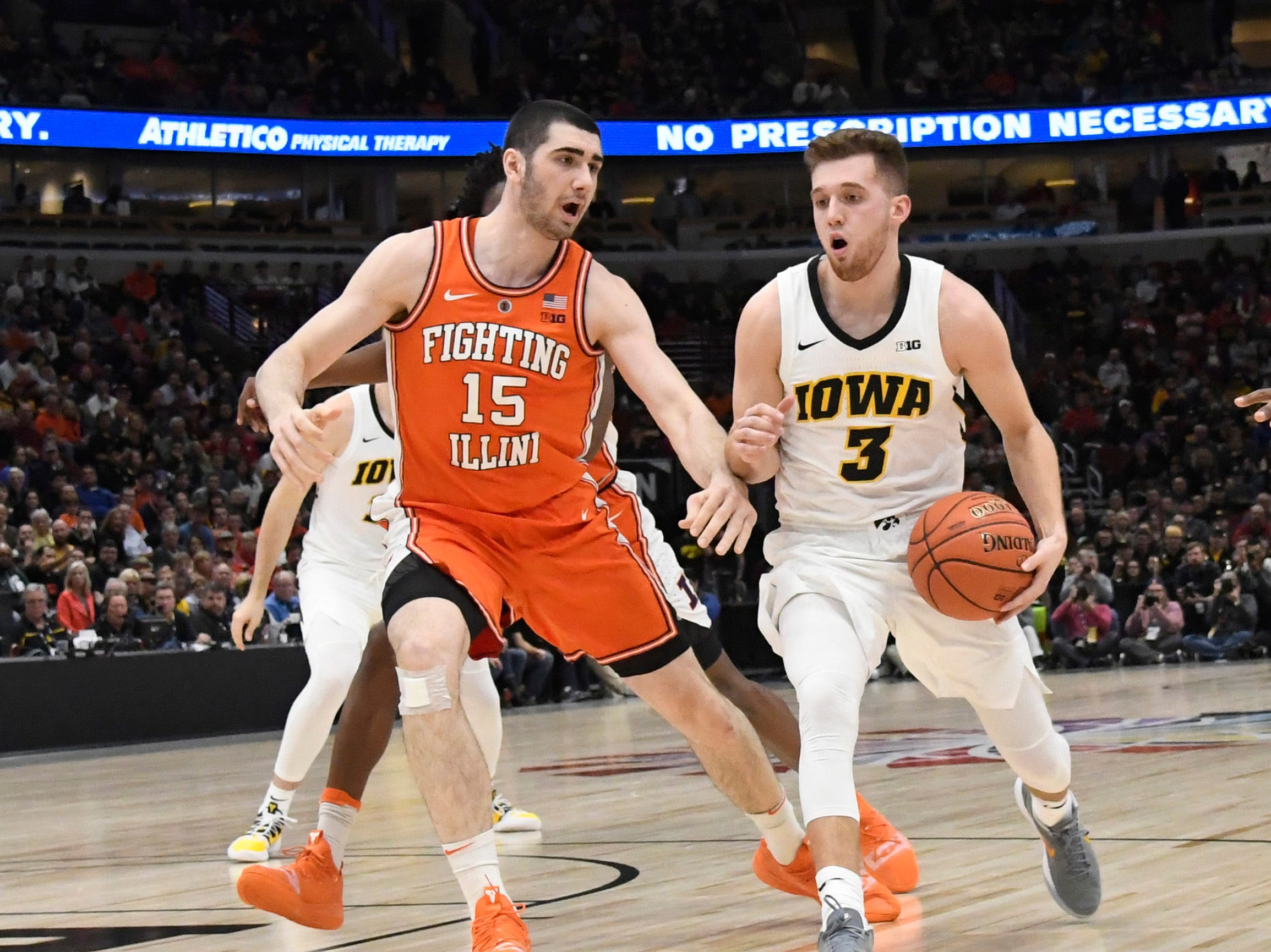 Mar 14, 2019; Chicago, IL, USA; Illinois Fighting Illini forward Giorgi Bezhanishvili (15) defends Iowa Hawkeyes guard Jordan Bohannon (3) during the first half in the Big Ten conference tournament at United Center. Mandatory Credit: David Banks-USA TODAY Sports