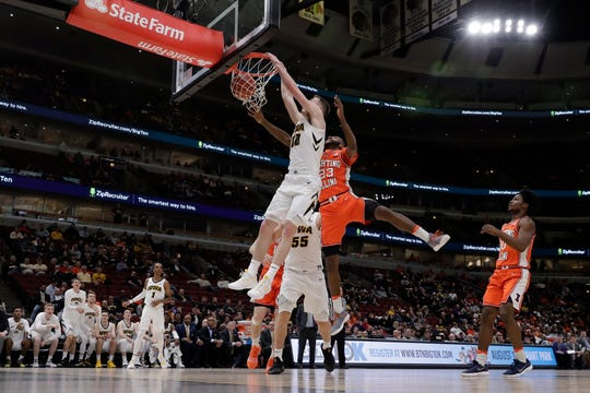Iowa's Joe Wieskamp dunks on Illinois, just as he promised teammate Tyler Cook he would, in Thursday's 83-62 win in the Big Ten Tournament at the United Center. Wieskamp, a freshman, finished with 13 points and seven rebounds to help lead the Hawkeye charge.