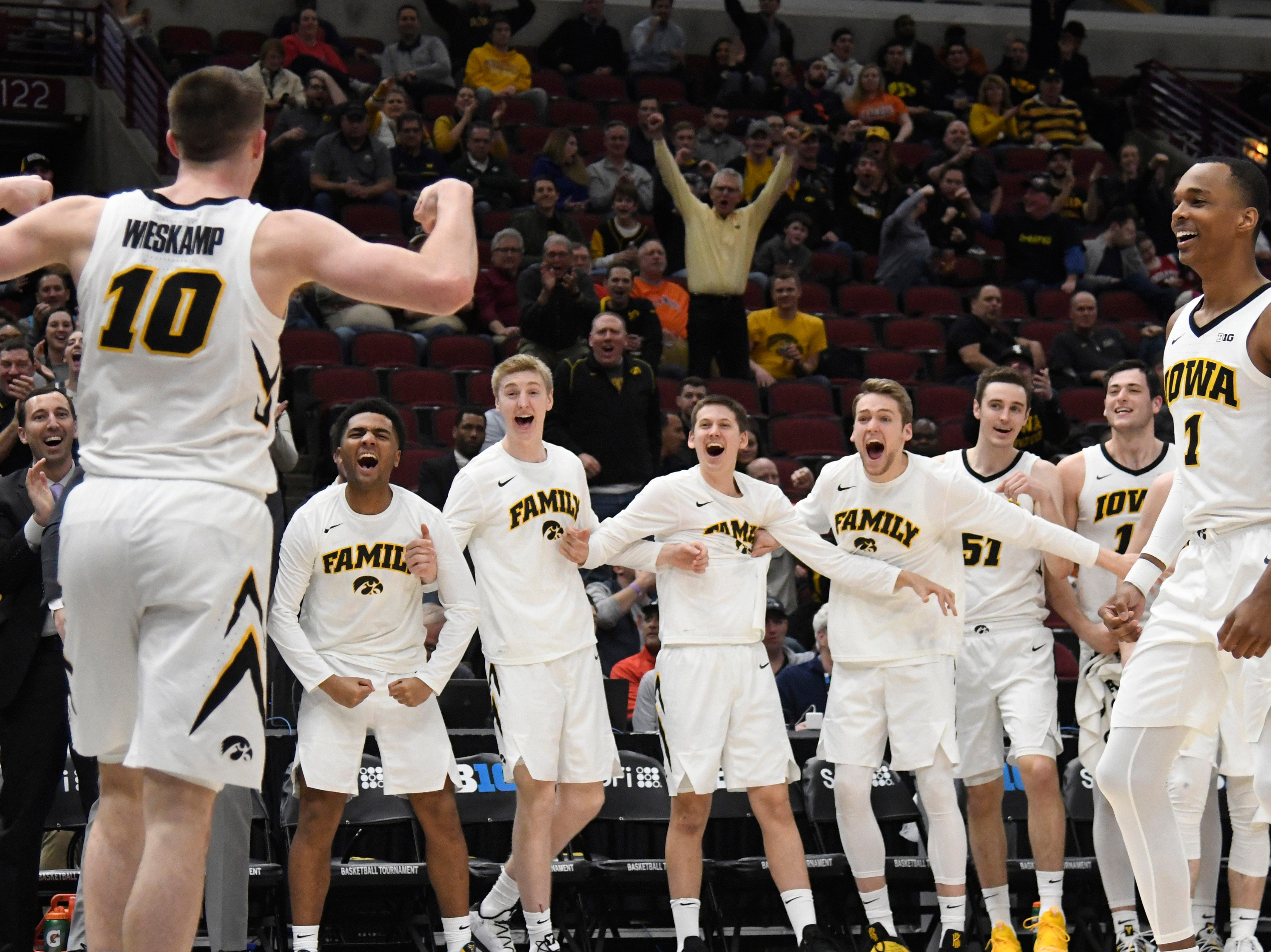Mar 14, 2019; Chicago, IL, USA; Iowa Hawkeyes guard Joe Wieskamp (10) reacts with his teammates after his dunk against the Illinois Fighting Illini during the second half in the Big Ten conference tournament at United Center. Mandatory Credit: David Banks-USA TODAY Sports