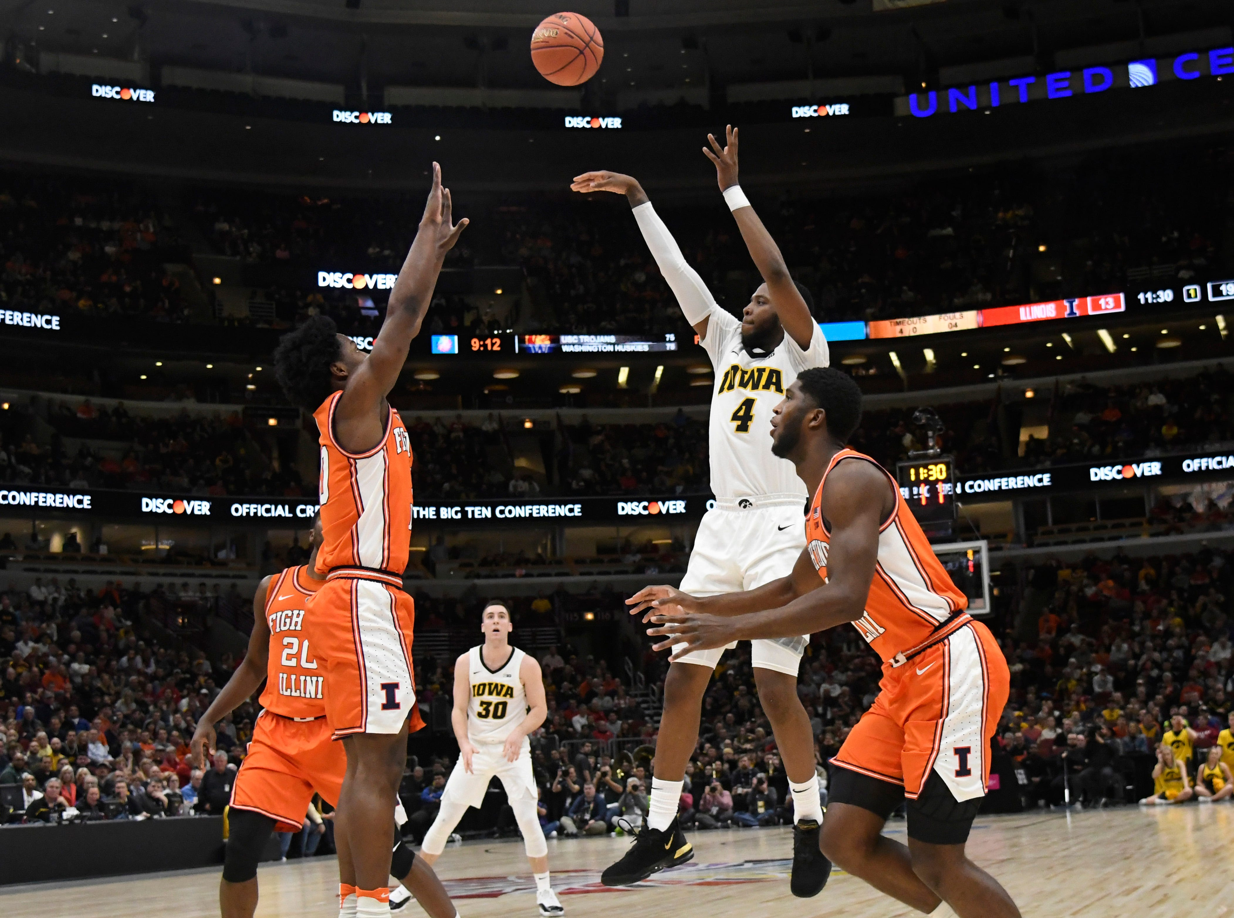 Mar 14, 2019; Chicago, IL, USA; Iowa Hawkeyes guard Isaiah Moss (4) shoots against the Illinois Fighting Illini during the first half in the Big Ten conference tournament at United Center. Mandatory Credit: David Banks-USA TODAY Sports