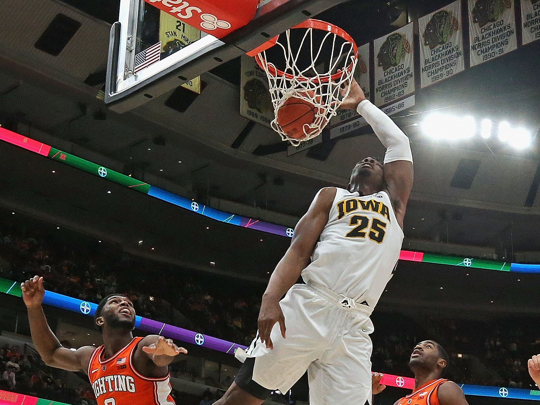 CHICAGO, ILLINOIS - MARCH 14: Tyler Cook #25 of the Iowa Hawkeyes dunks over Kipper Nichols #2 of the Illinois Fighting Illini at the United Center on March 14, 2019 in Chicago, Illinois. Iowa defeated Illinois 83-62. (Photo by Jonathan Daniel/Getty Images)