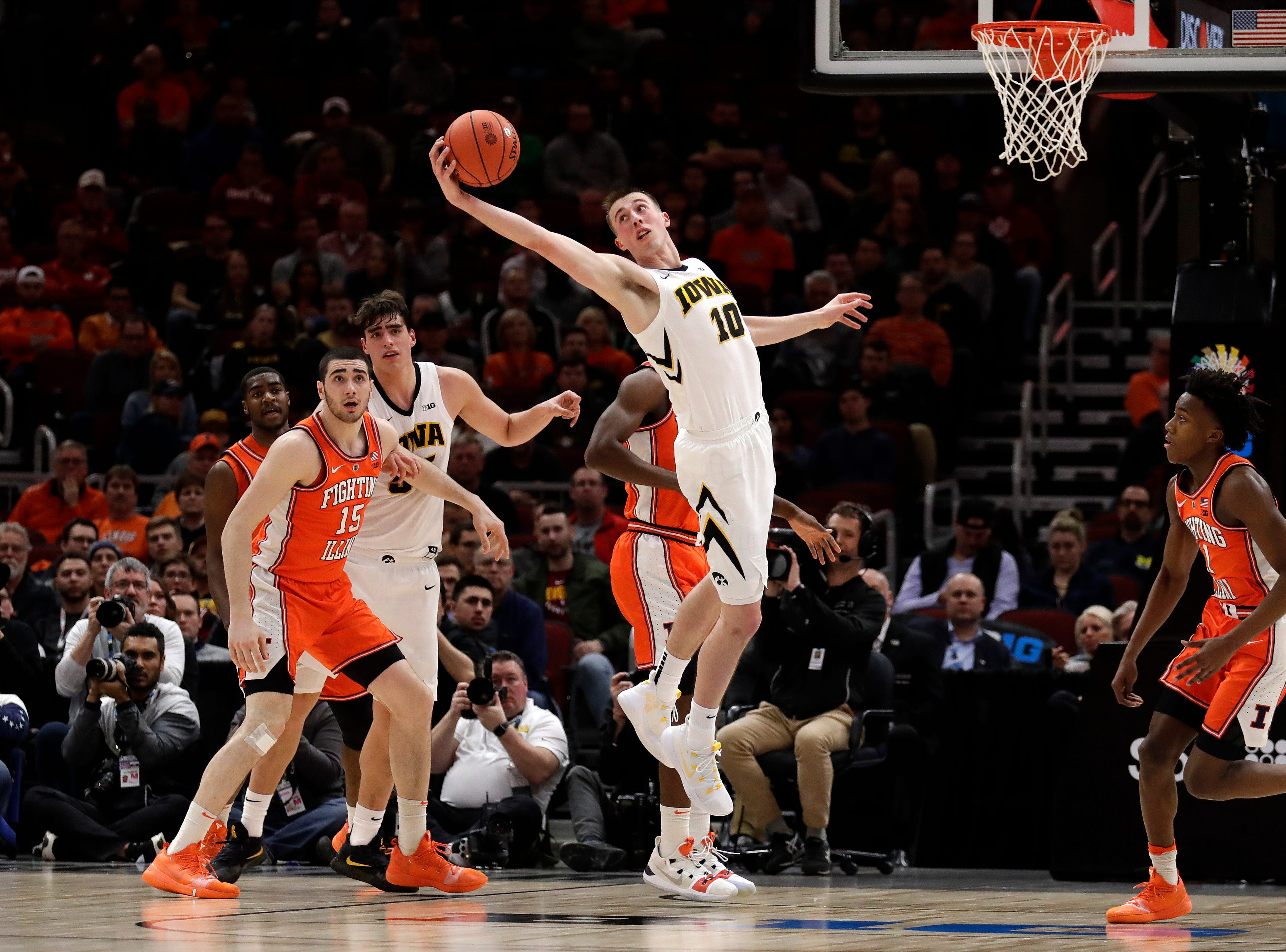 Iowa's Joe Wieskamp (10) reaches for a rebound during the first half of an NCAA college basketball game against the Illinois in the second round of the Big Ten Conference tournament, Thursday, March 14, 2019, in Chicago. (AP Photo/Nam Y. Huh)