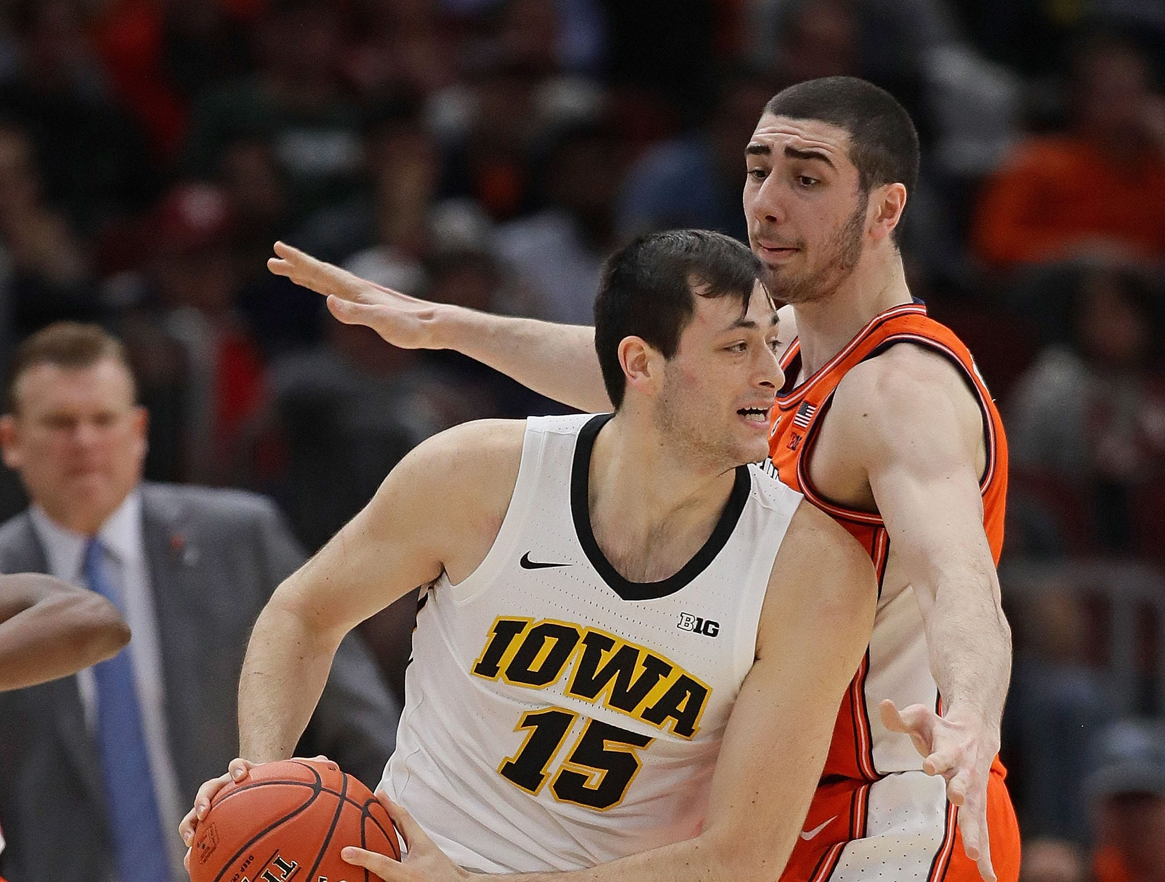 CHICAGO, ILLINOIS - MARCH 14: Ryan Kriener #15 of the Iowa Hawkeyes moves against Giorgi Bezhanishvili #15 of the Illinois Fighting Illini at the United Center on March 14, 2019 in Chicago, Illinois.  (Photo by Jonathan Daniel/Getty Images)