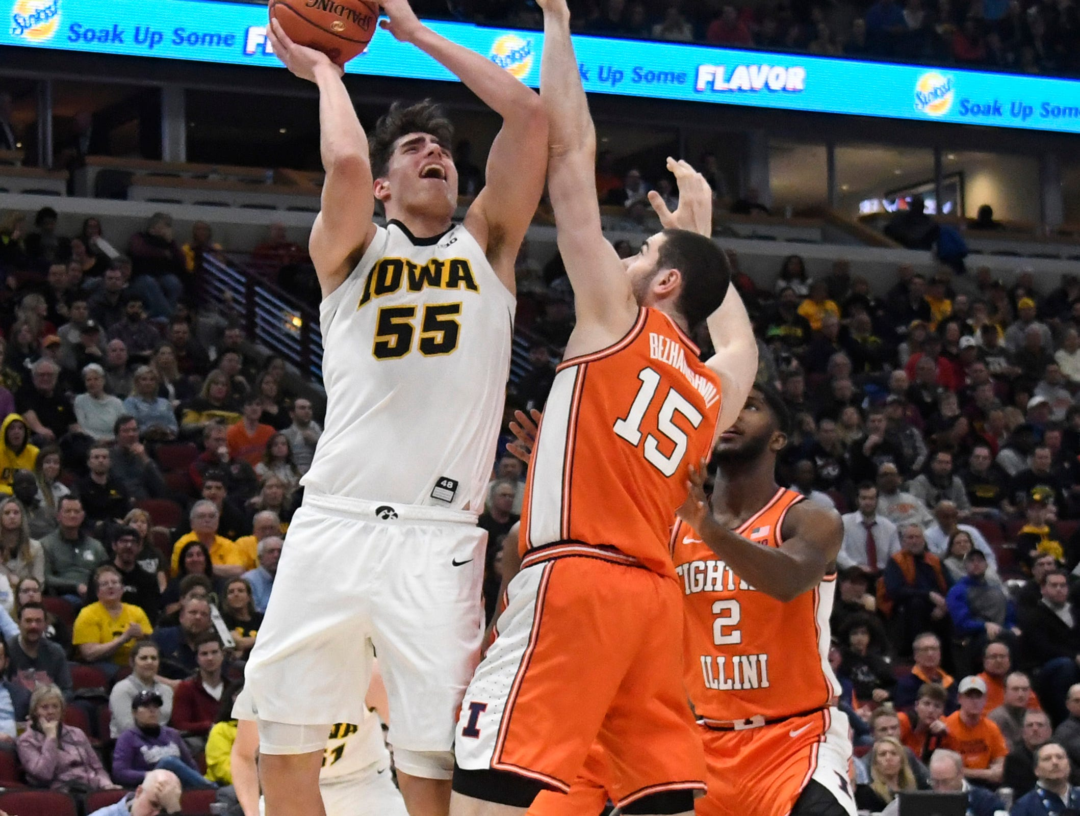 Mar 14, 2019; Chicago, IL, USA; Iowa Hawkeyes forward Ryan Kriener (15) shoots over Illinois Fighting Illini forward Giorgi Bezhanishvili (15) during the first half in the Big Ten conference tournament at United Center. Mandatory Credit: David Banks-USA TODAY Sports