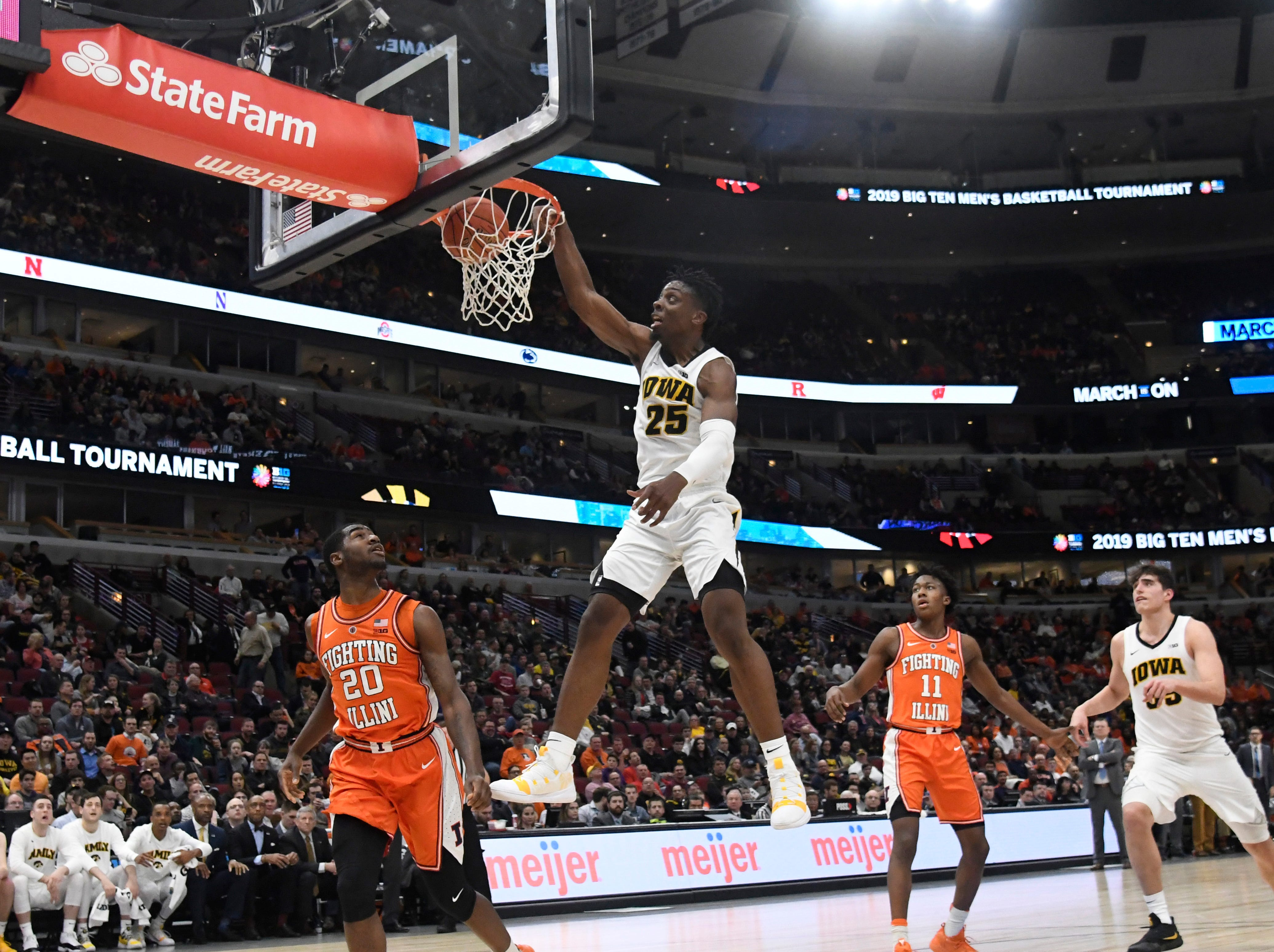 Mar 14, 2019; Chicago, IL, USA; Iowa Hawkeyes forward Tyler Cook (25) dunks the ball as Illinois Fighting Illini guard Da'Monte Williams (20) looks on during the second half in the Big Ten conference tournament at United Center. Mandatory Credit: David Banks-USA TODAY Sports