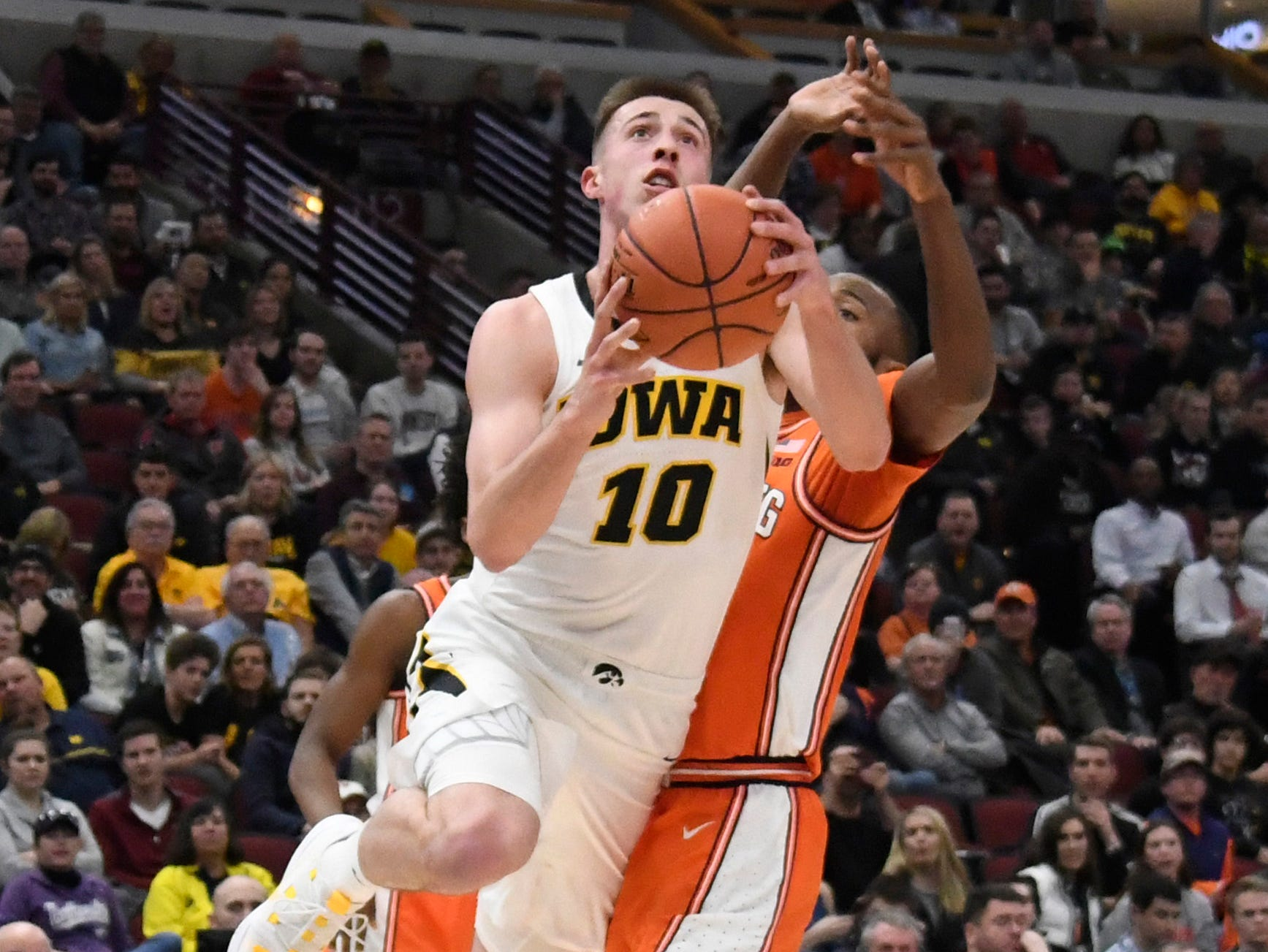 Mar 14, 2019; Chicago, IL, USA;Iowa Hawkeyes guard Joe Wieskamp (10) goes to the basket against the Illinois Fighting Illini during the first half in the Big Ten conference tournament at United Center. Mandatory Credit: David Banks-USA TODAY Sports