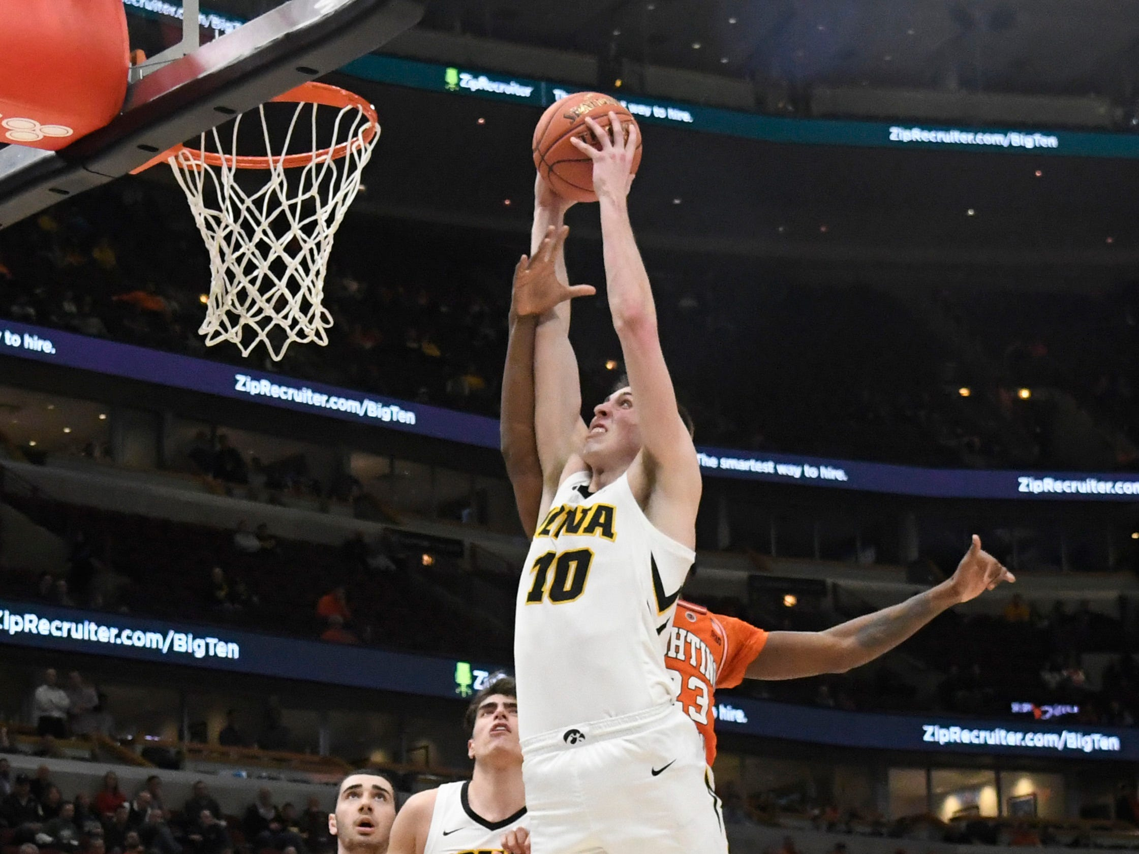 Mar 14, 2019; Chicago, IL, USA; Iowa Hawkeyes guard Joe Wieskamp (10) goes up for a dunk against the Illinois Fighting Illini during the second half in the Big Ten conference tournament at United Center. Mandatory Credit: David Banks-USA TODAY Sports
