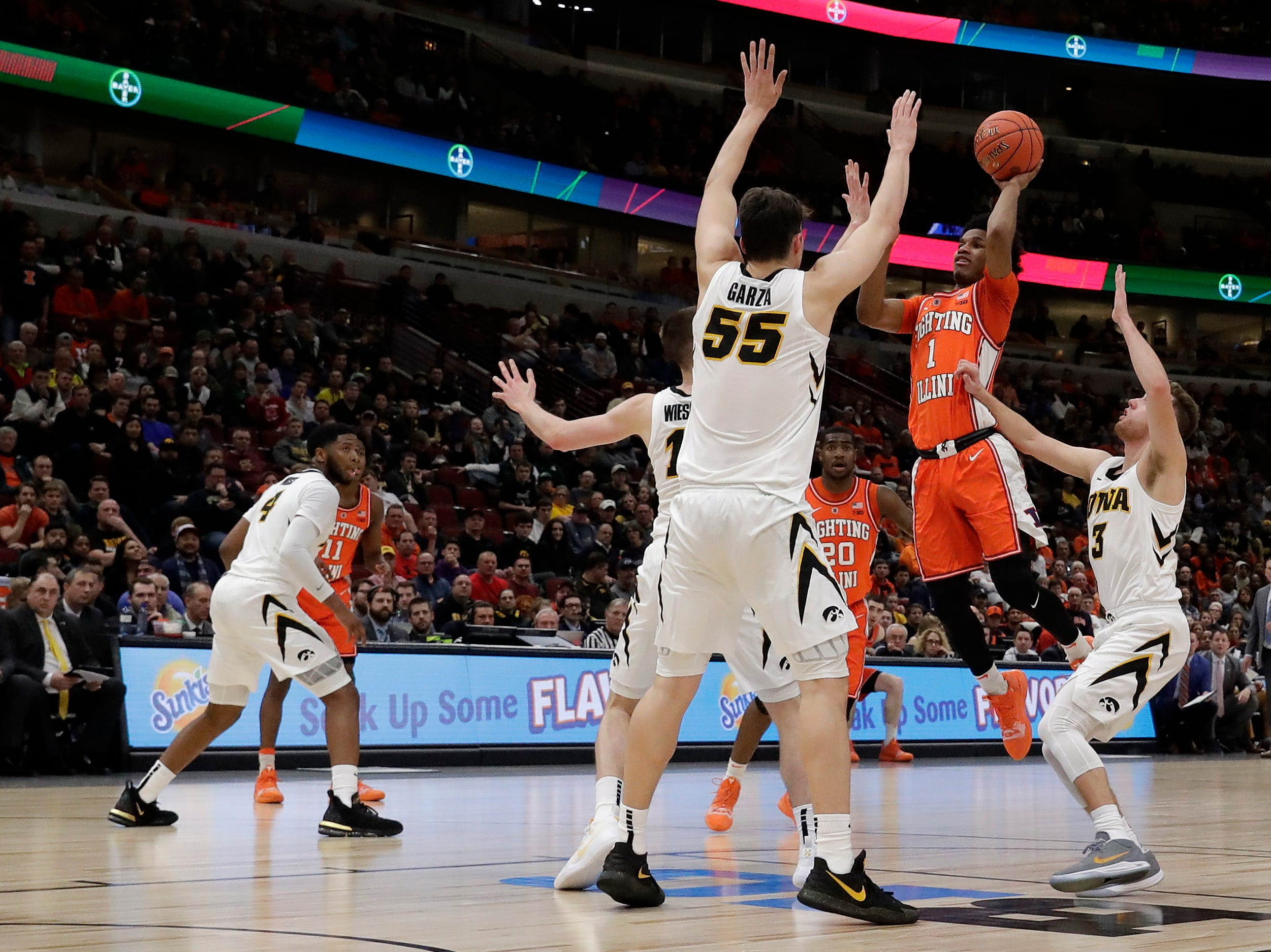 Illinois's Trent Frazier (1) takes a shot against the Iowa defense during the first half of an NCAA college basketball game in the second round of the Big Ten Conference tournament, Thursday, March 14, 2019, in Chicago. (AP Photo/Nam Y. Huh)