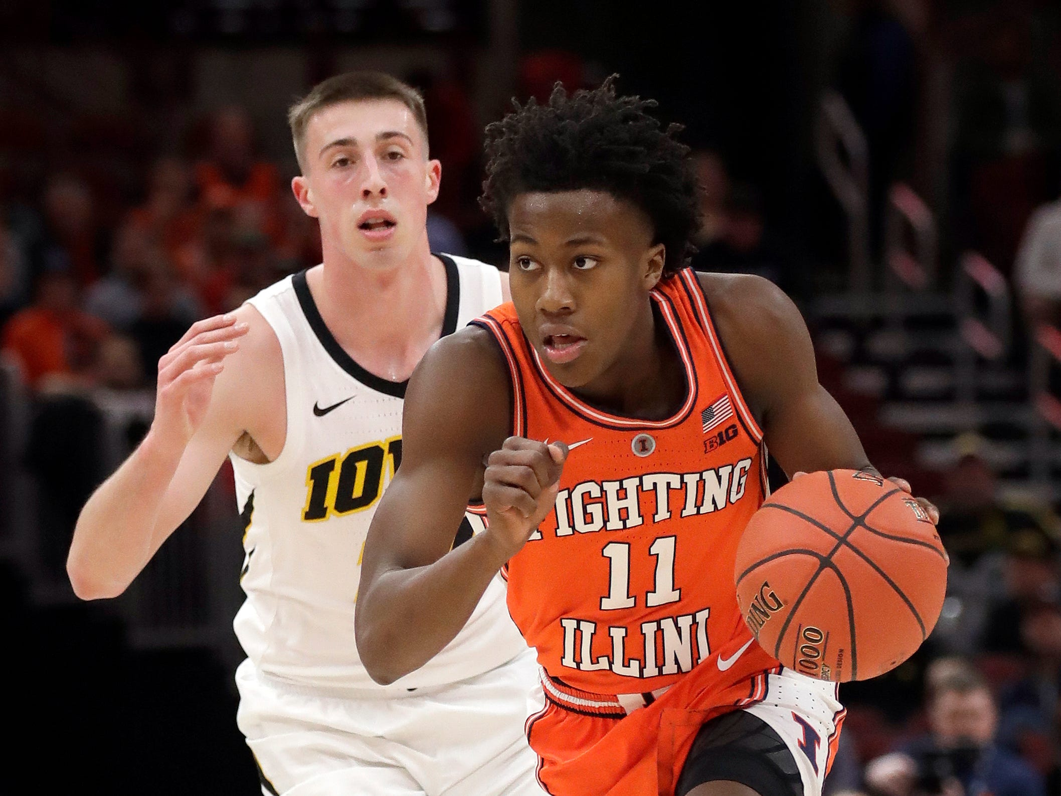 Illinois's Ayo Dosunmu (11) drives against Iowa's Joe Wieskamp during the first half of an NCAA college basketball game in the second round of the Big Ten Conference tournament, Thursday, March 14, 2019, in Chicago. (AP Photo/Nam Y. Huh)