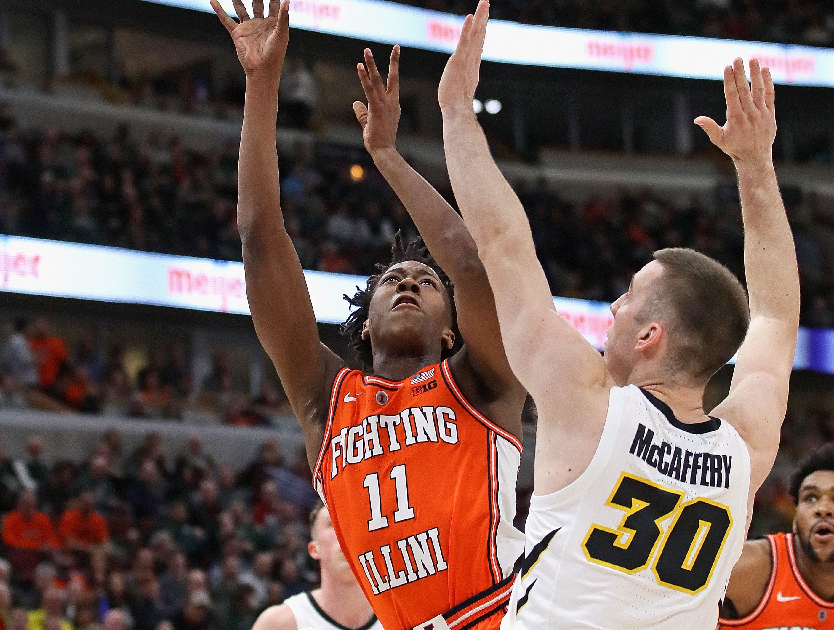 CHICAGO, ILLINOIS - MARCH 14: Ayo Dosunmu #11 of the Illinois Fighting Illini shoots against Connor McCaffery #30 of the Iowa Hawkeyes at the United Center on March 14, 2019 in Chicago, Illinois.  (Photo by Jonathan Daniel/Getty Images)