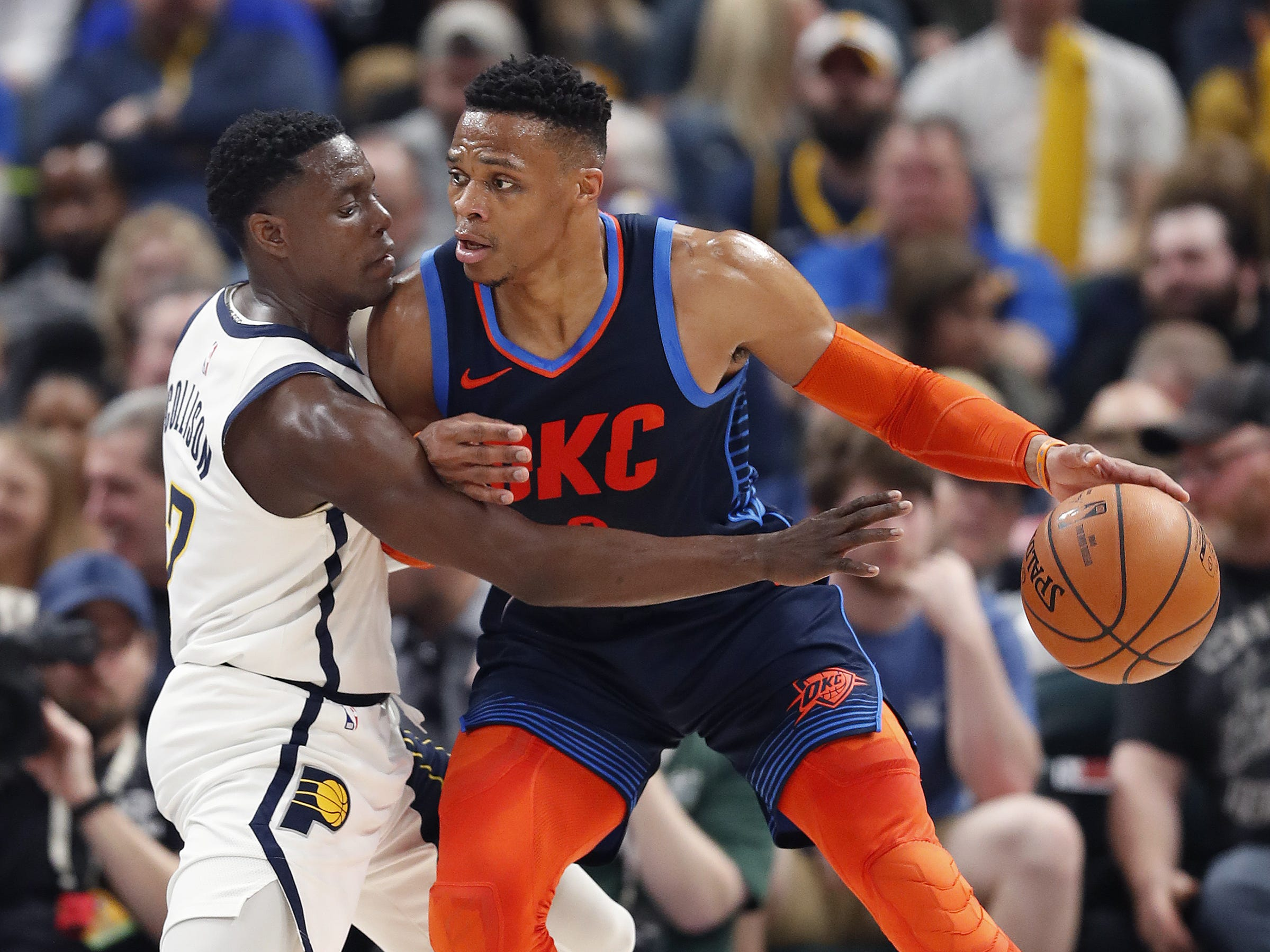 Indiana Pacers guard Darren Collison (2) defends Oklahoma City Thunder guard Russell Westbrook (0) in the first half of their game at Bankers Life Fieldhouse on Thursday, Mar. 14, 2019.