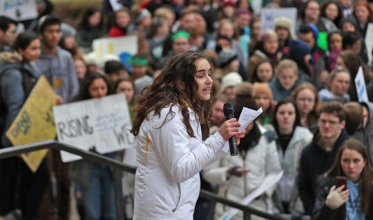 Carmel High School sophomore Isabella Fallahi speaks to students during the Indiana part of the international Climate Strike, Friday, March 15, 2019, held outside the Indiana Statehouse.  Following in the footsteps of 16-year-old Swedish trailblazer, Greta Thunberg, students around the world are skipping school to protest government inaction on climate change.  The Indiana protest brought over 250 participants.