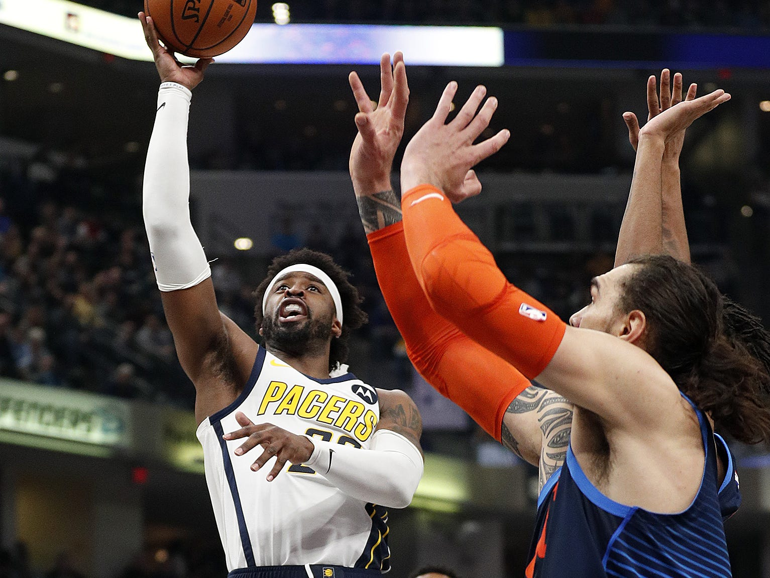 Indiana Pacers guard Wesley Matthews (23) shoots over Oklahoma City Thunder center Steven Adams (12) in the first half of their game at Bankers Life Fieldhouse on Thursday, Mar. 14, 2019.