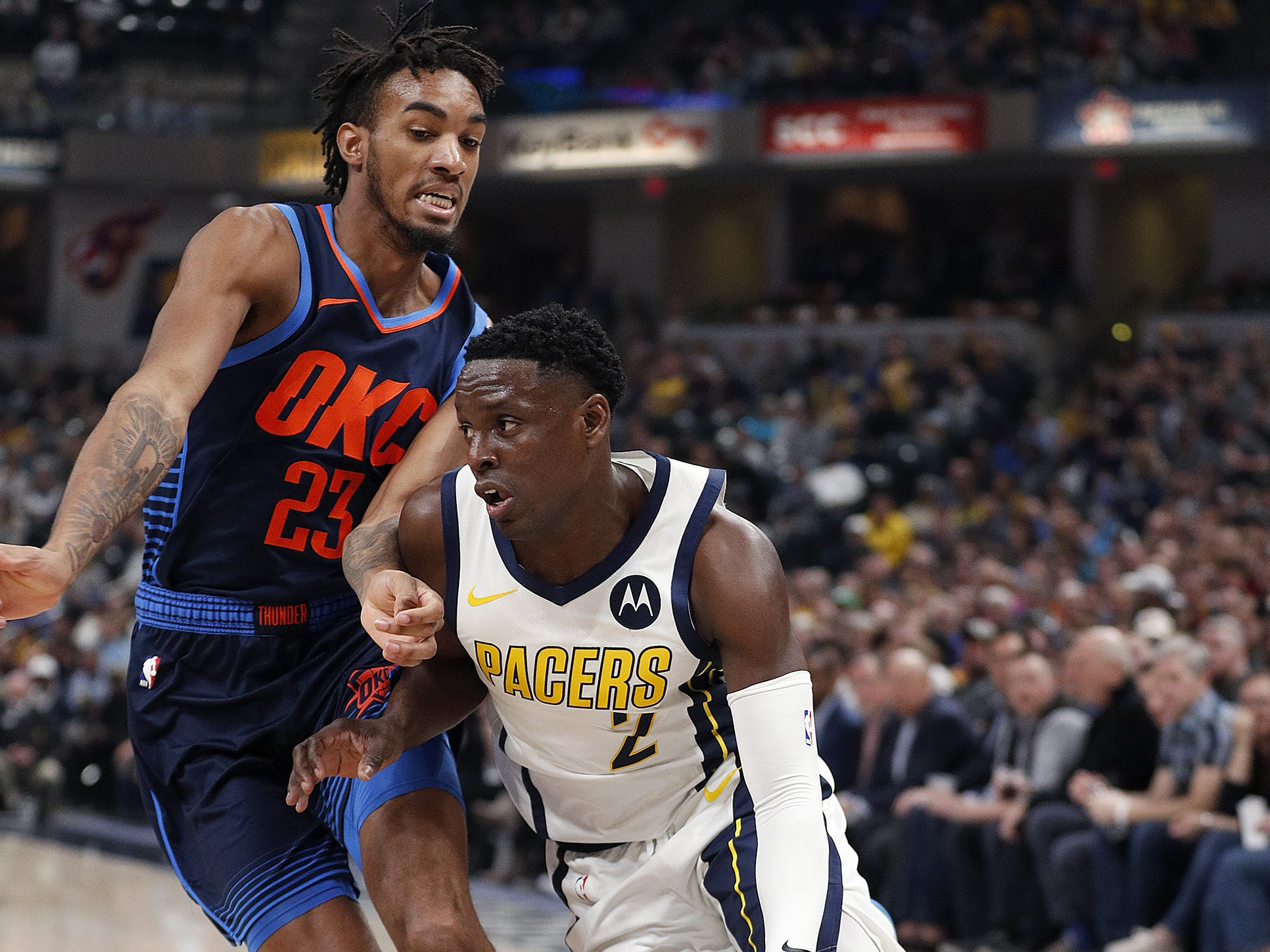 Indiana Pacers guard Darren Collison (2) drives to the basker on Oklahoma City Thunder guard Terrance Ferguson (23) in the first half of their game at Bankers Life Fieldhouse on Thursday, Mar. 14, 2019.