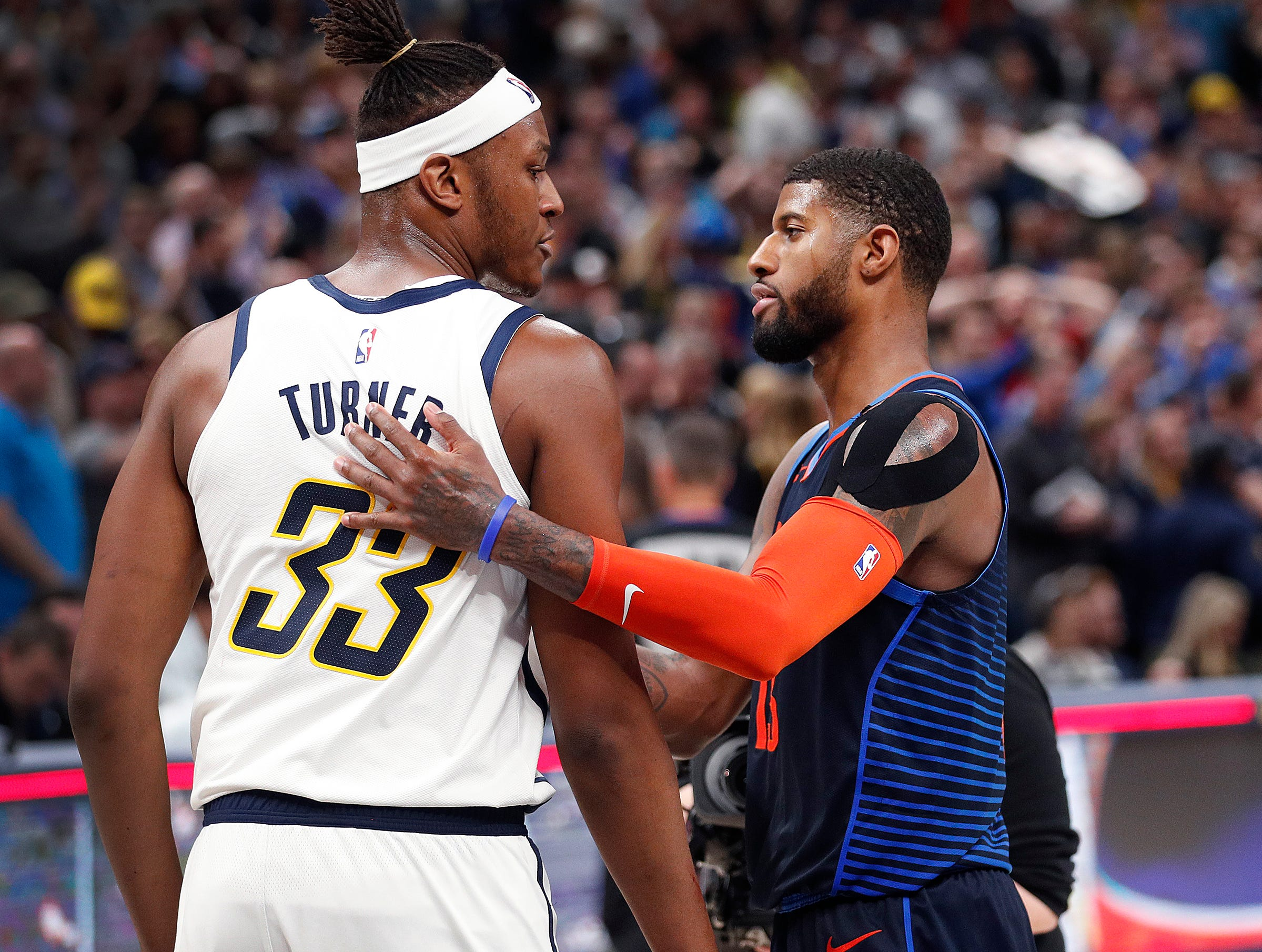 Indiana Pacers center Myles Turner (33) and Oklahoma City Thunder forward Paul George (13) greets eachother following  their game at Bankers Life Fieldhouse on Thursday, Mar. 14, 2019. The Pacers defeated the Thunder 108-106.