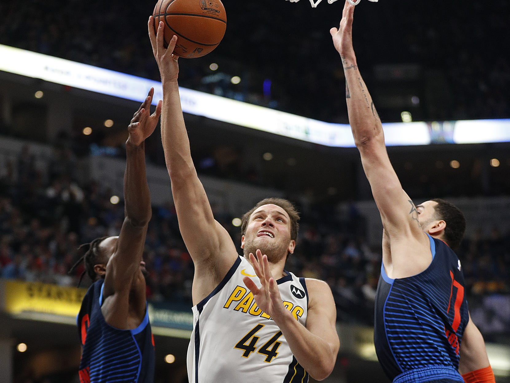 Indiana Pacers forward Bojan Bogdanovic (44) drives by Oklahoma City Thunder forward Abdel Nader (11) in the first half of their game at Bankers Life Fieldhouse on Thursday, Mar. 14, 2019.
