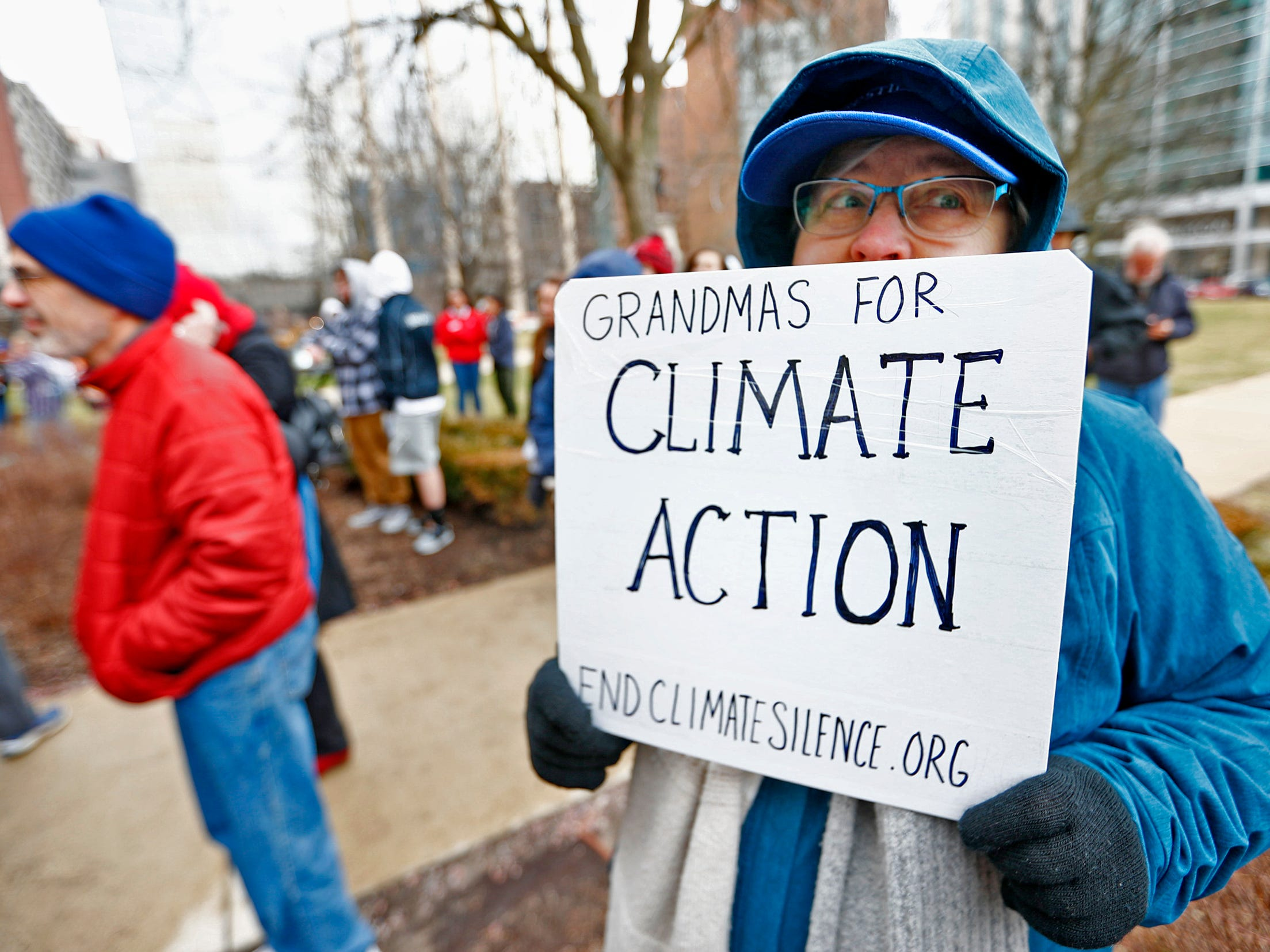 """Brenda Mick, a """"Grandma for climate change,"""" comes to support the Indiana part of the international Climate Strike, Friday, March 15, 2019, held outside the Indiana Statehouse.  She is protesting for her granddaughter.  Mick says she wants her to know about polar bears.  Following in the footsteps of 16-year-old Swedish trailblazer, Greta Thunberg, students around the world are skipping school to protest government inaction on climate change."""