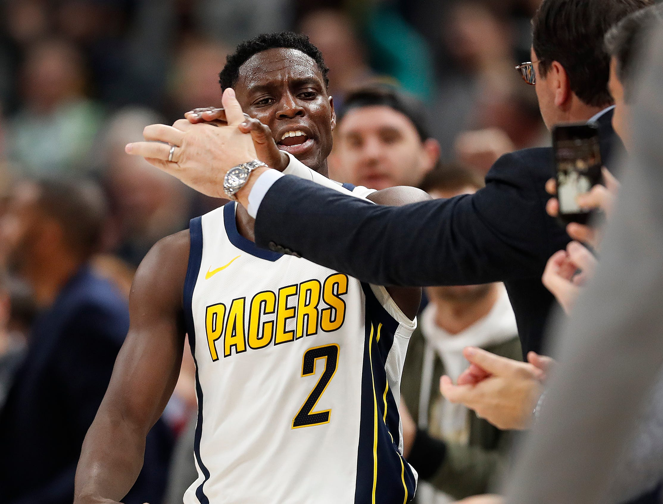 Indiana Pacers guard Darren Collison (2) high fives Pacers fans in the second half of their game at Bankers Life Fieldhouse on Thursday, Mar. 14, 2019. The Pacers defeated the Thunder 108-106.