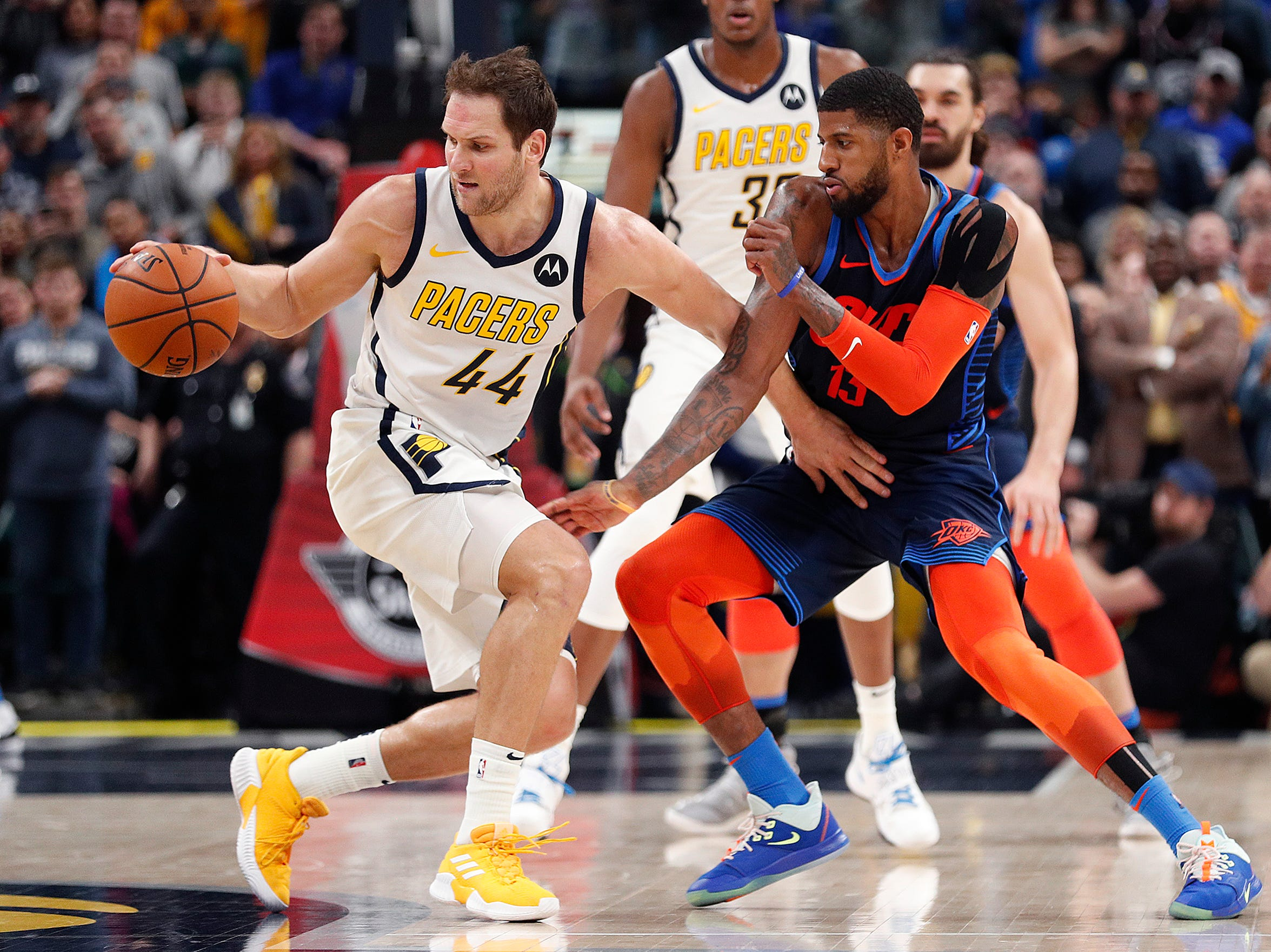 Indiana Pacers forward Bojan Bogdanovic (44) spins around Oklahoma City Thunder forward Paul George (13) in the final second of the fourth quarter of their game at Bankers Life Fieldhouse on Thursday, Mar. 14, 2019. The Pacers defeated the Thunder 108-106.