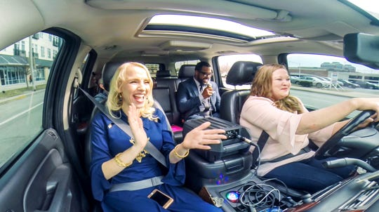 IndyStar's Justin Mack, rear right, sings Uber 'caraoke' with driver Angela Byers, right, and International Recording Artist, Anita Lerche, left, on Wednesday, February 27, 2019.  Angela offers her UBER customers a unique experience, a chance to sing karaoke, or as she likes to call it, 'caraoke'.