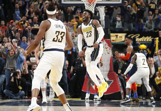 Indiana Pacers guard Wesley Matthews (23) leaps in the air after hitting the game-winning shot in the final seconds in the fourth quarter of their game at Bankers Life Fieldhouse on Thursday, Mar. 14, 2019. The Pacers defeated the Thunder 108-106.