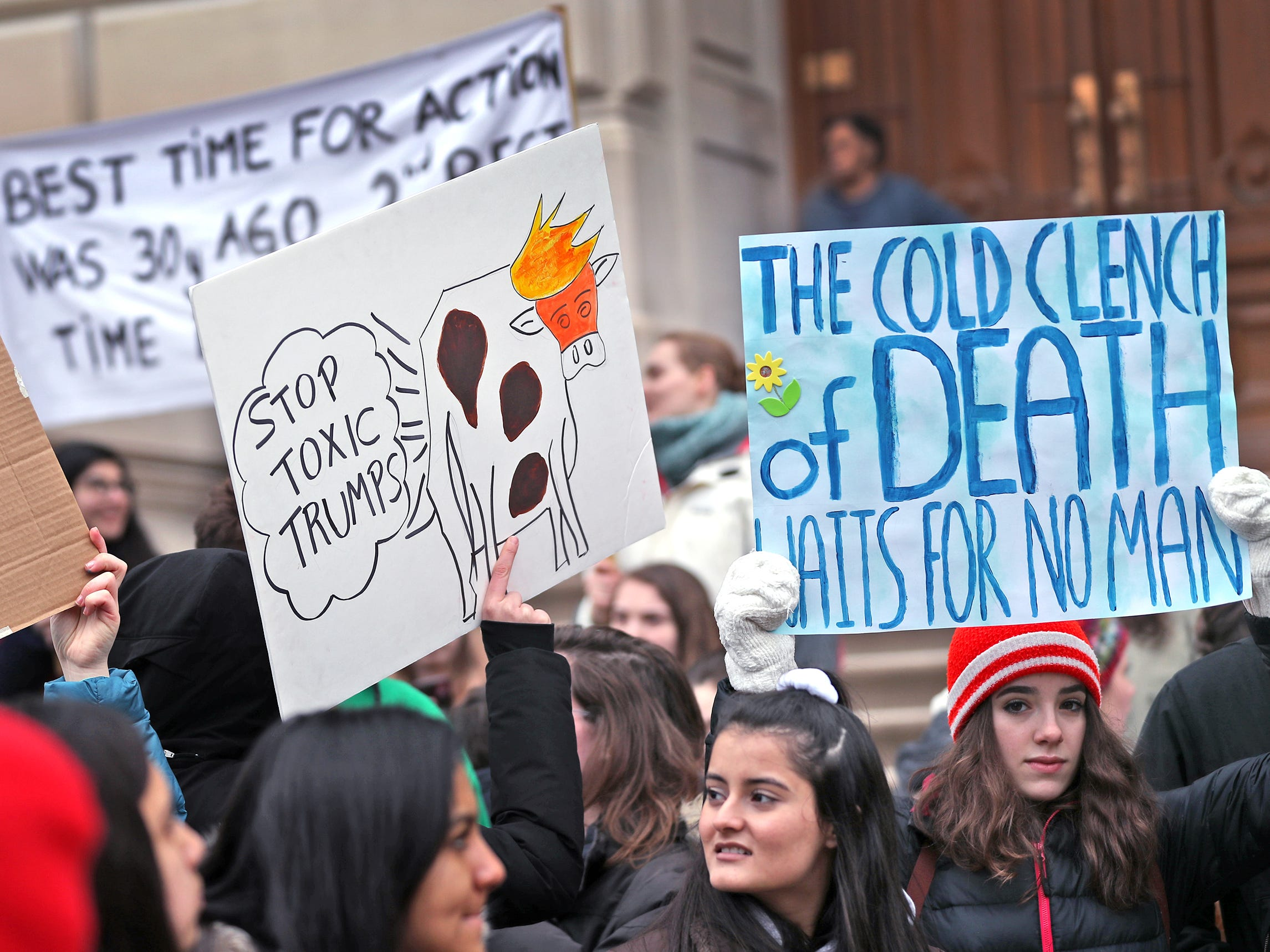 Students come together with a variety of signs during the Indiana part of the international Climate Strike, Friday, March 15, 2019, held outside the Indiana Statehouse.  Some of the signs referenced President Trump.  Following in the footsteps of 16-year-old Swedish trailblazer, Greta Thunberg, students around the world are skipping school to protest government inaction on climate change.  The Indiana protest brought over 250 participants.