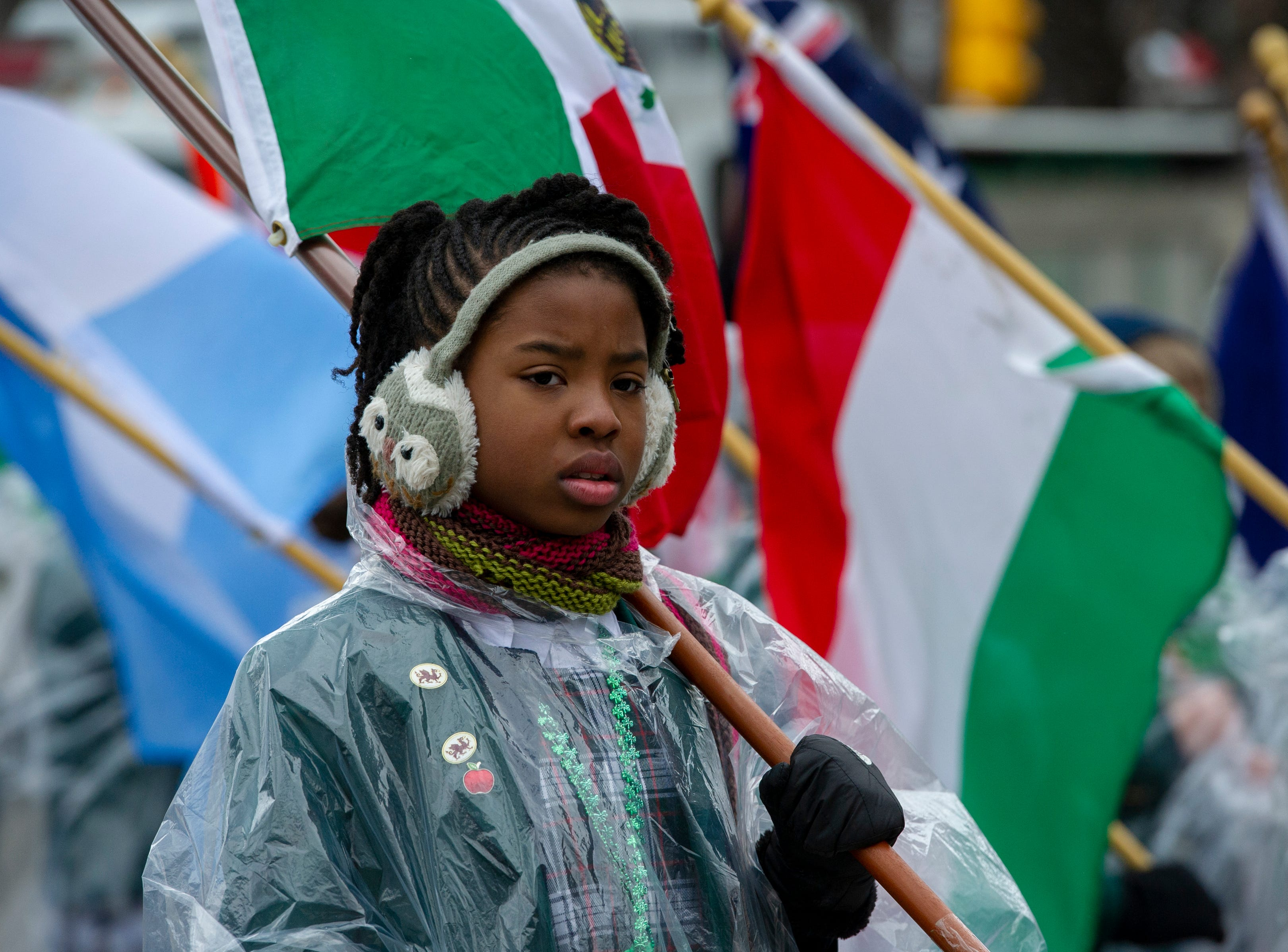 Chloe Moss, 10, waits for the St. Richards Episcopal School parade unit to head onto the route. The 39th annual St. Patrick's Day Parade navigated the streets of Indianapolis, Friday, March 15, 2019.