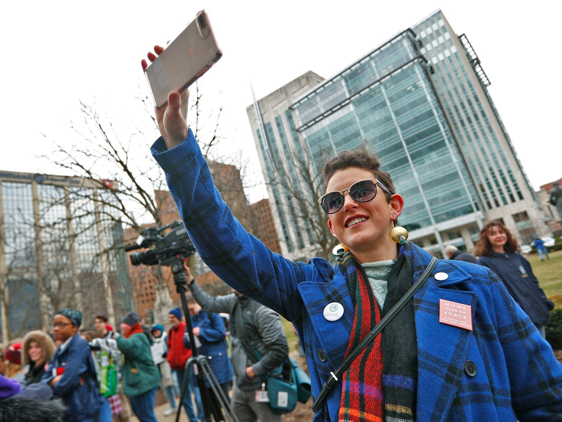 Amanda Shepherd photographs kids protesting, during the Indiana part of the international Climate Strike, Friday, March 15, 2019, held outside the Indiana Statehouse. Her daughter, who participated, is an Allisonville Elementary student. Following in the footsteps of 16-year-old Swedish trailblazer, Greta Thunberg, students around the world are skipping school to protest government inaction on climate change.