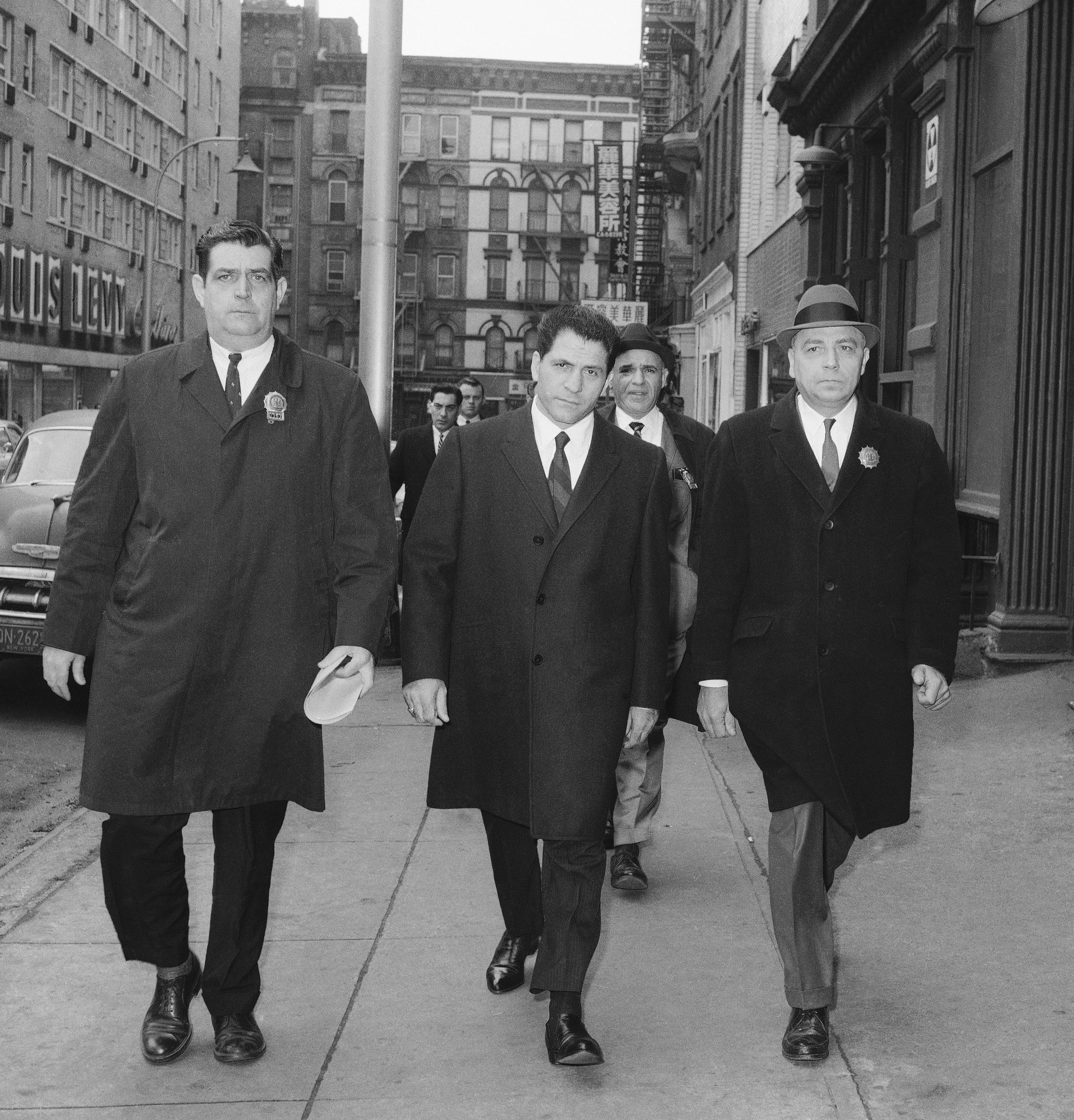 """Sonny Franzese makes his way to a New York police station in 1966.  """"I killed a lot of guys,"""" he was once caught on tape admitting, """"you're not talking about four, five, six, 10."""""""