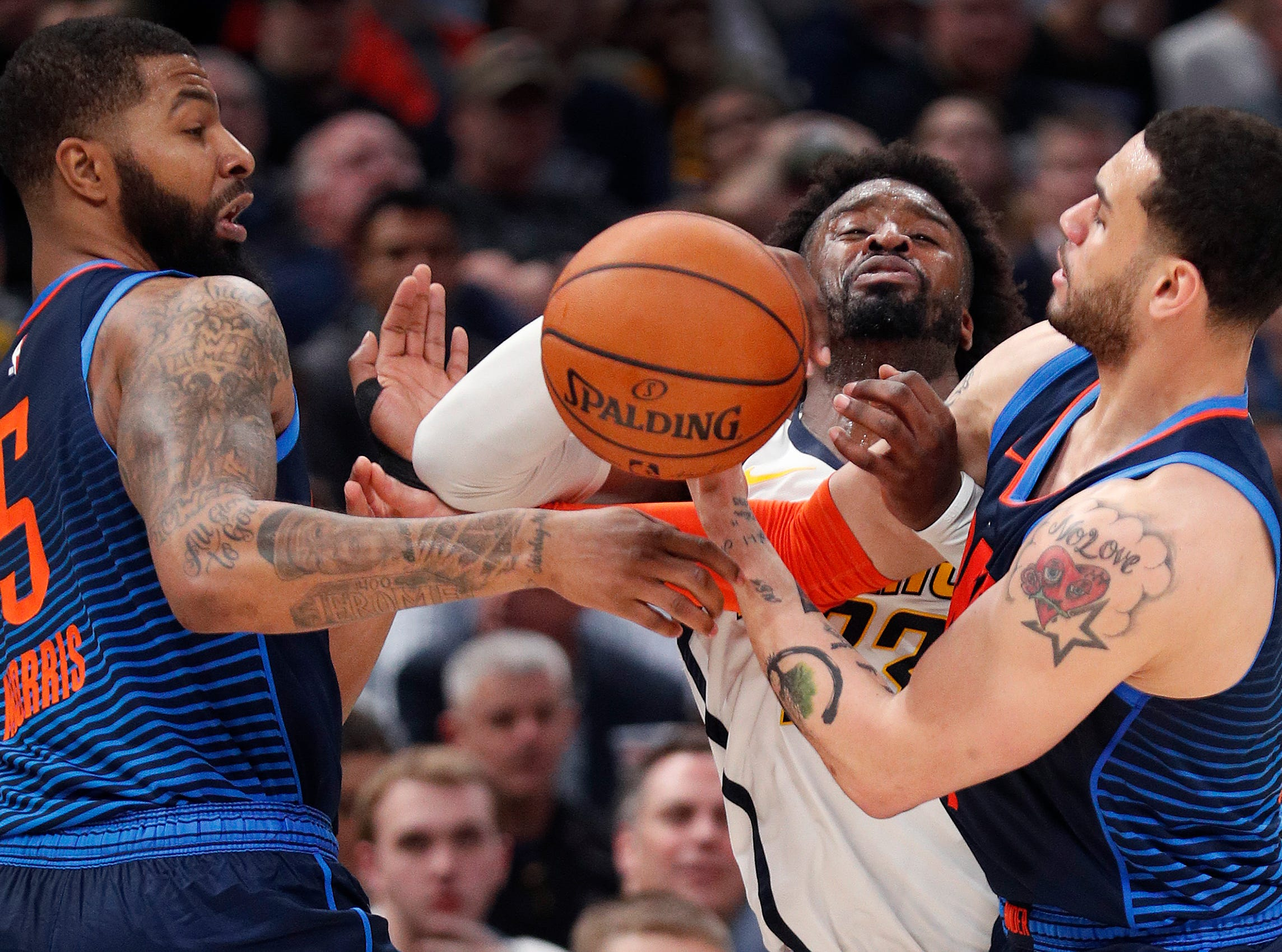 Indiana Pacers guard Wesley Matthews (23) is fouled by Oklahoma City Thunder forward Abdel Nader (11), right, and forward Markieff Morris (5) in the second half of their game at Bankers Life Fieldhouse on Thursday, Mar. 14, 2019. The Pacers defeated the Thunder 108-106.