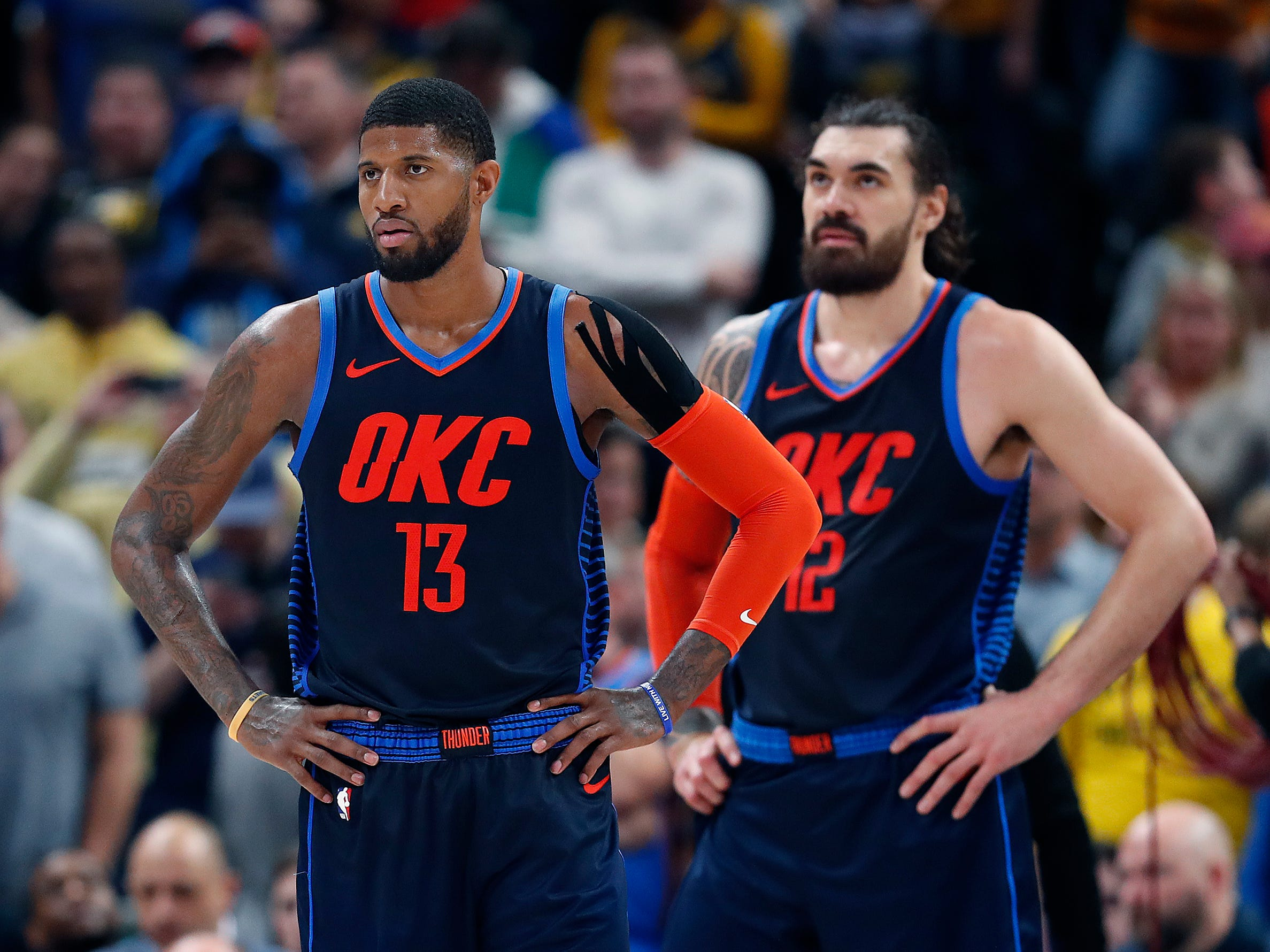 Dejected Oklahoma City Thunder forward Paul George (13) and Steven Adams (12) late in the second half of their game at Bankers Life Fieldhouse on Thursday, Mar. 14, 2019. The Pacers defeated the Thunder 108-106.