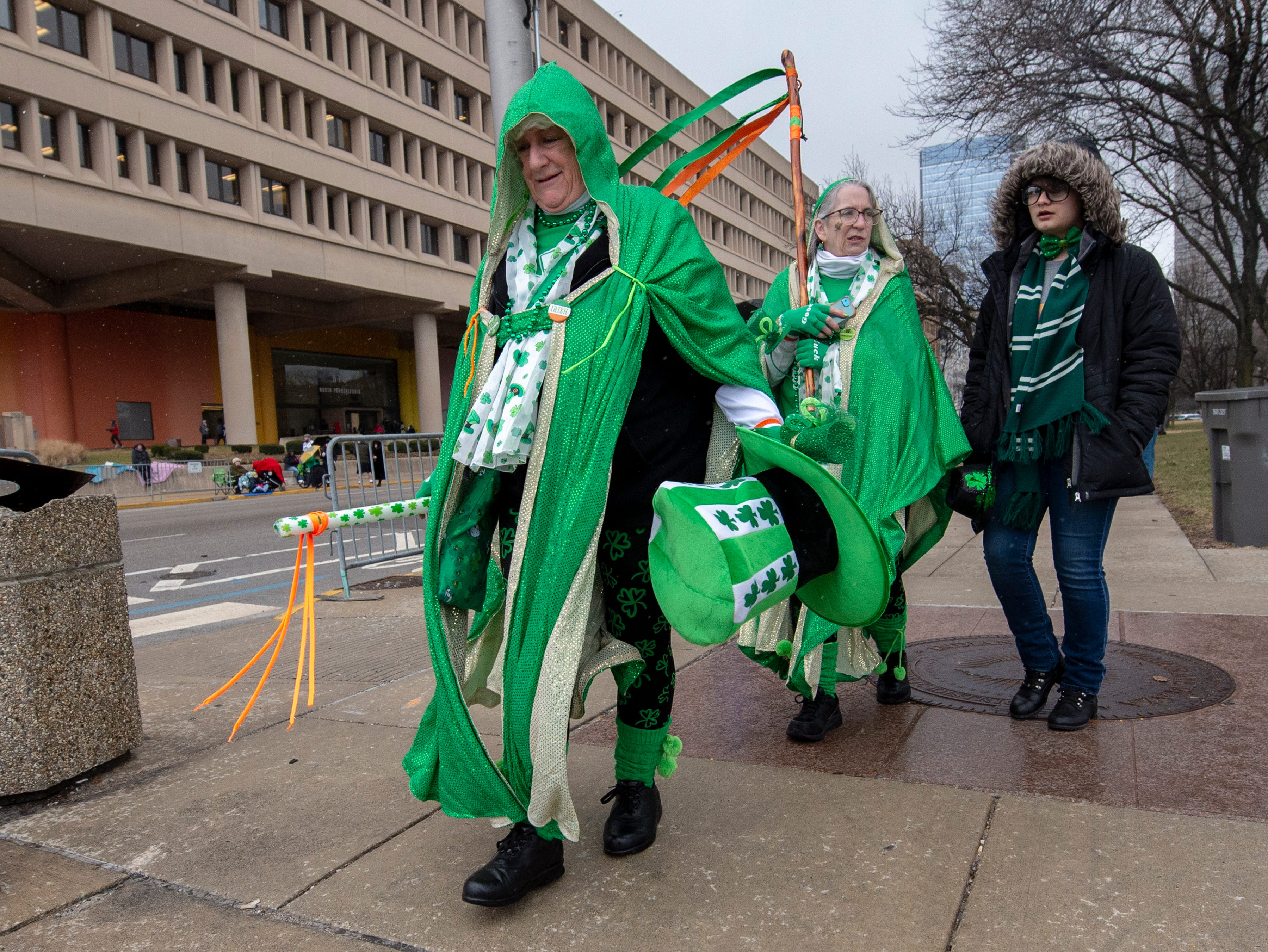 Parade goers, wearing their holiday best, walk along the parade route. The 39th annual St. Patrick's Day Parade navigated the streets of Indianapolis, Friday, March 15, 2019.