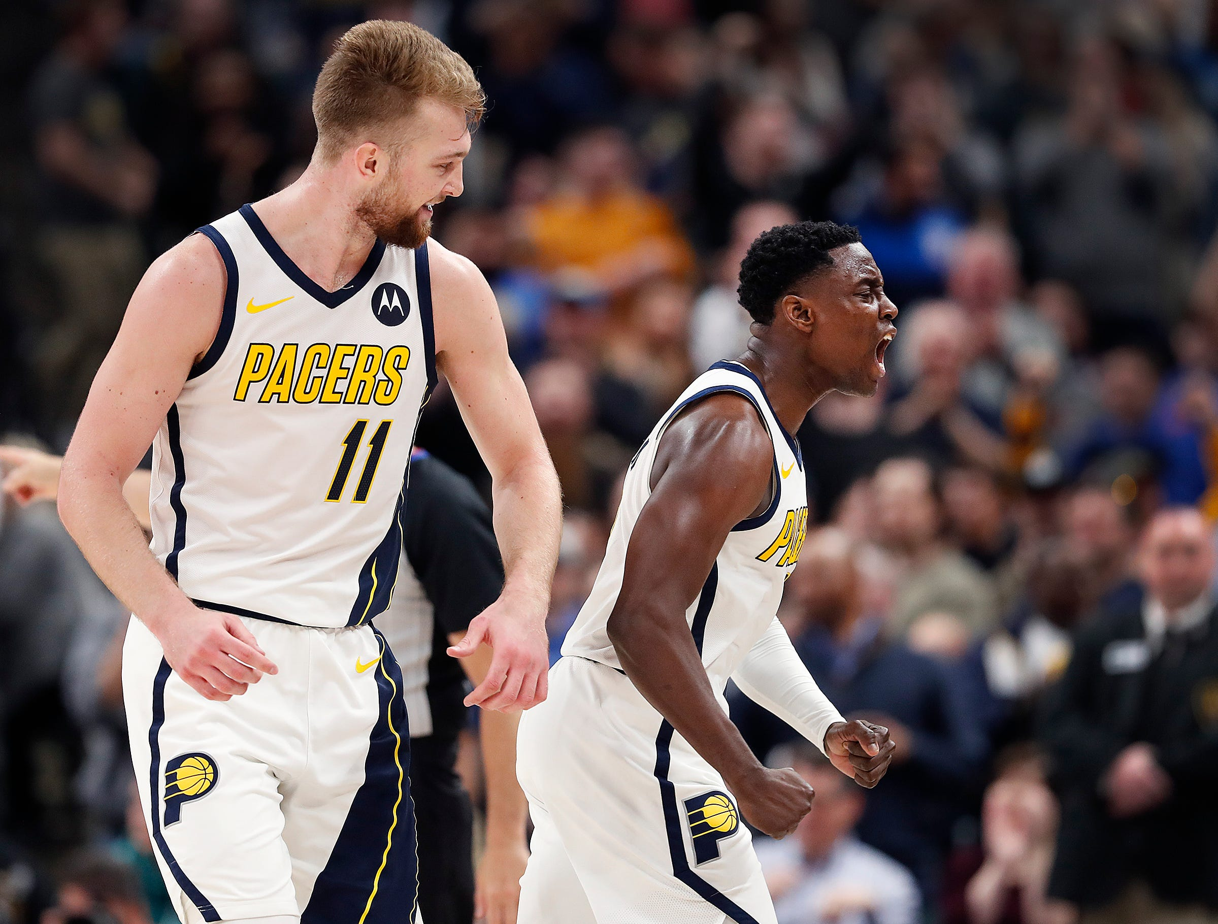 Indiana Pacers guard Darren Collison (2) celebrates with Domantas Sabonis (11) in the second half of their game at Bankers Life Fieldhouse on Thursday, Mar. 14, 2019. The Pacers defeated the Thunder 108-106.