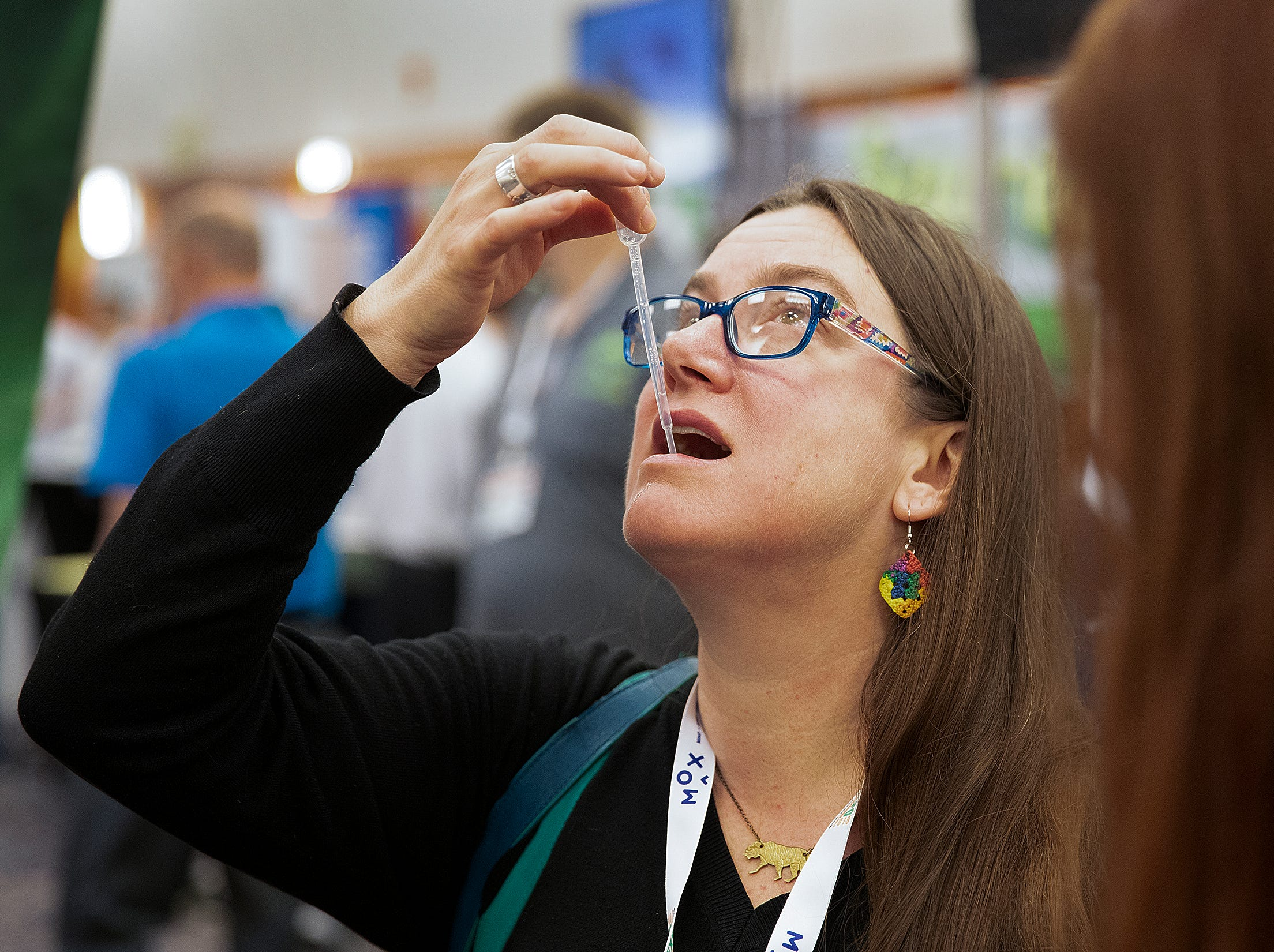 CBD Expo goers were encouraged to try different CBD oils at the CBD Expo at the Marriott East in Indianapolis on Friday, Mar. 15, 2019.