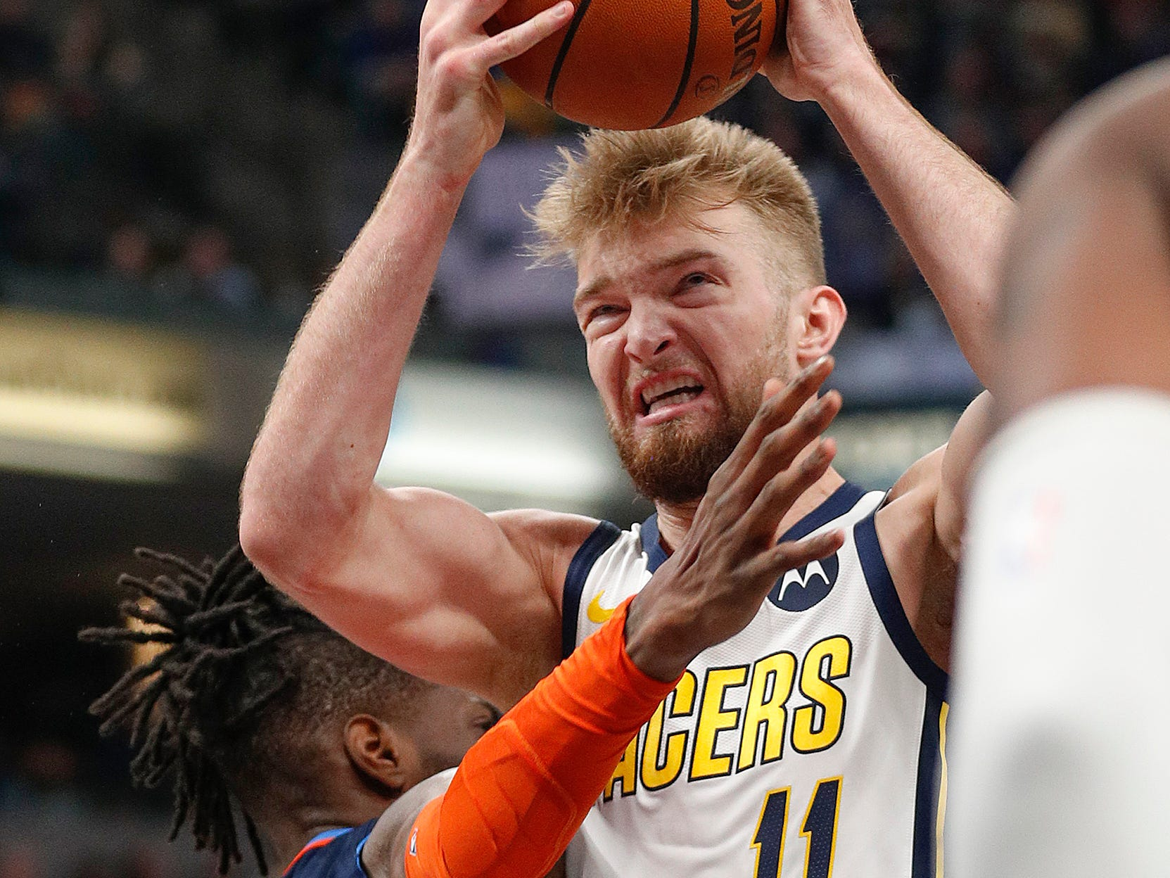 Indiana Pacers forward Domantas Sabonis (11) is fouled by Oklahoma City Thunder forward Nerlens Noel (3) in the first half of their game at Bankers Life Fieldhouse on Thursday, Mar. 14, 2019.
